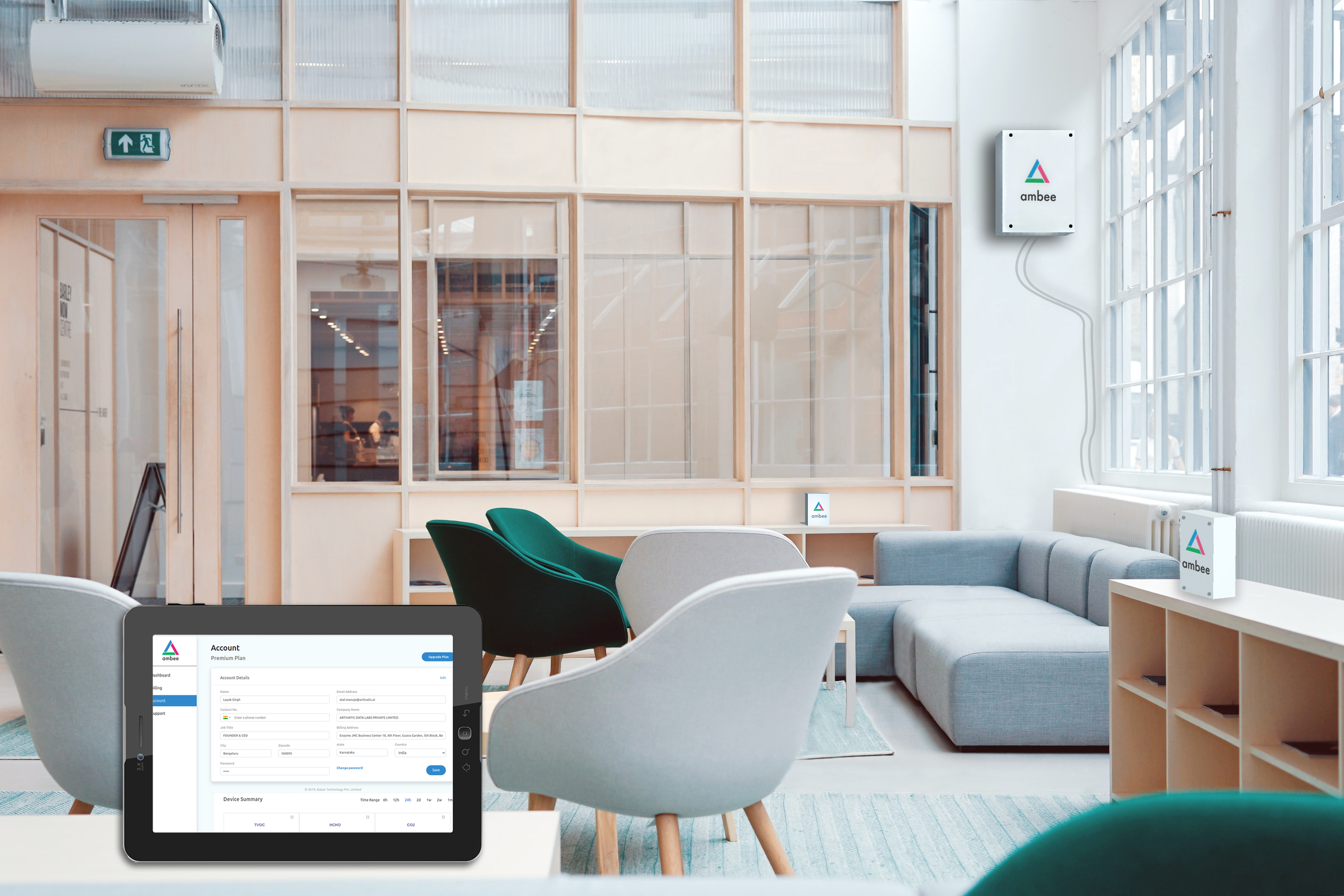 A clean looking room with air monitoring devices from Ambee places in three corners