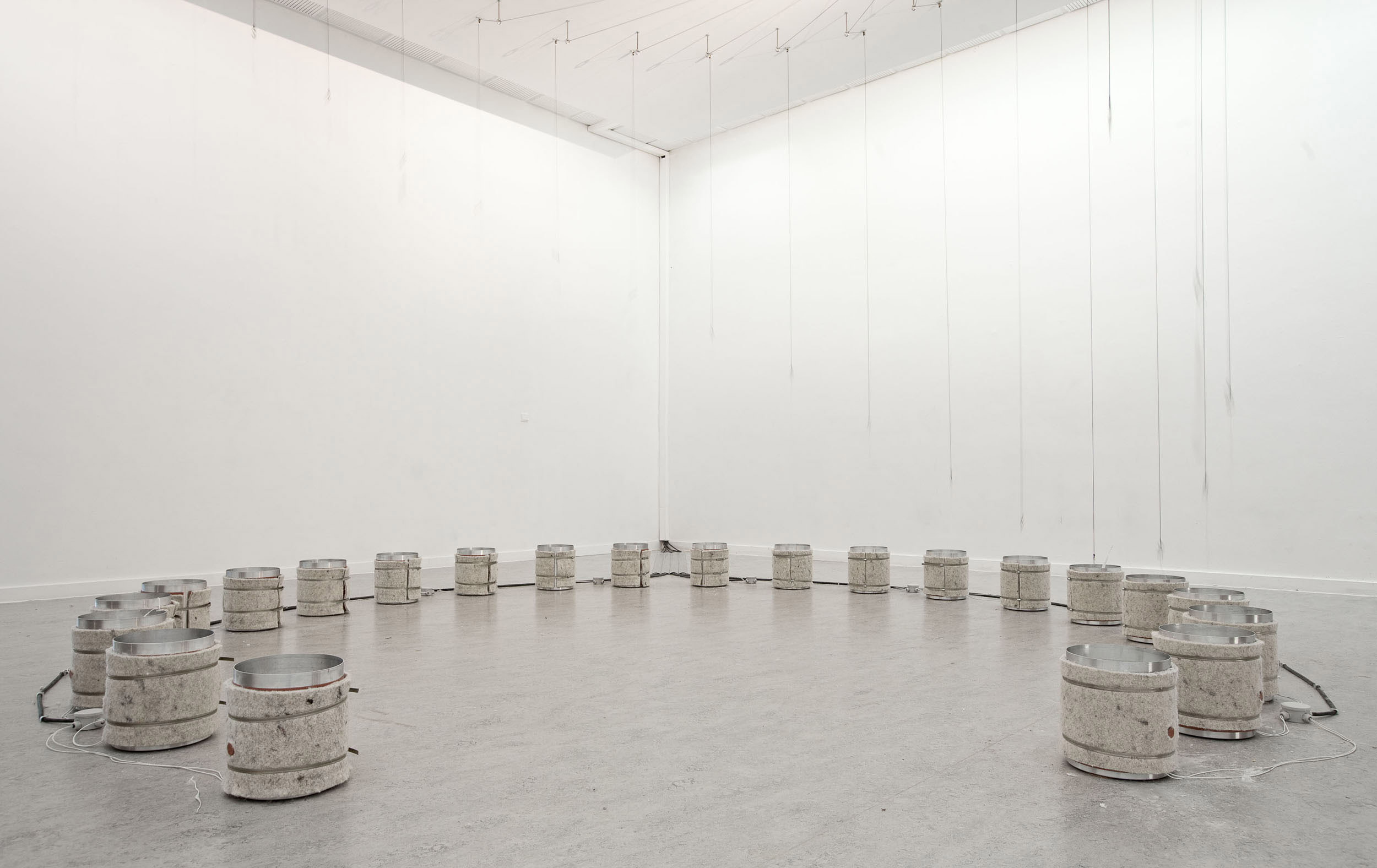 An overview of the dipping buckets and strings at Z33 gallery