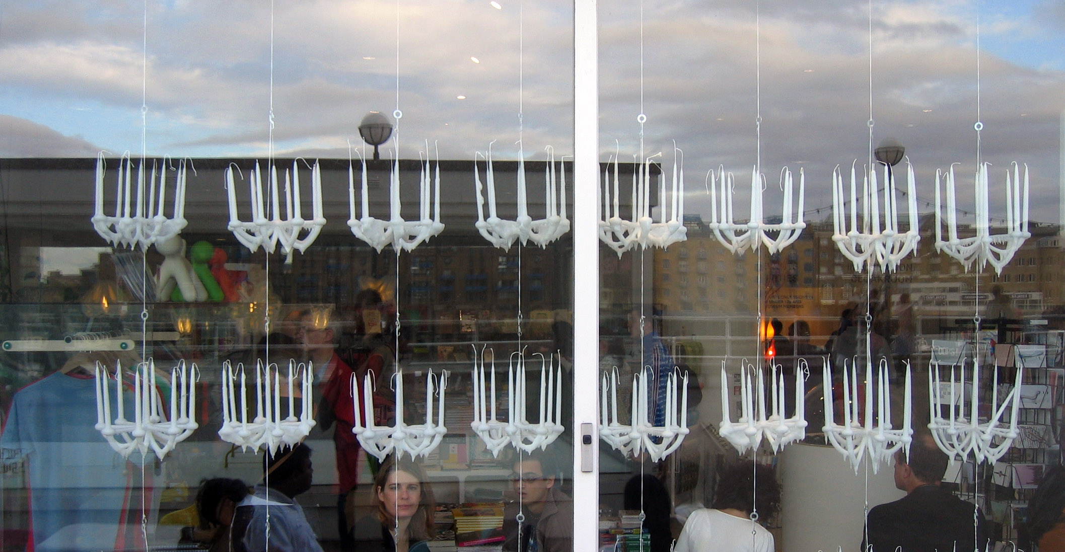 A harvest of chandeliers displayed in the window of the London Design Museum