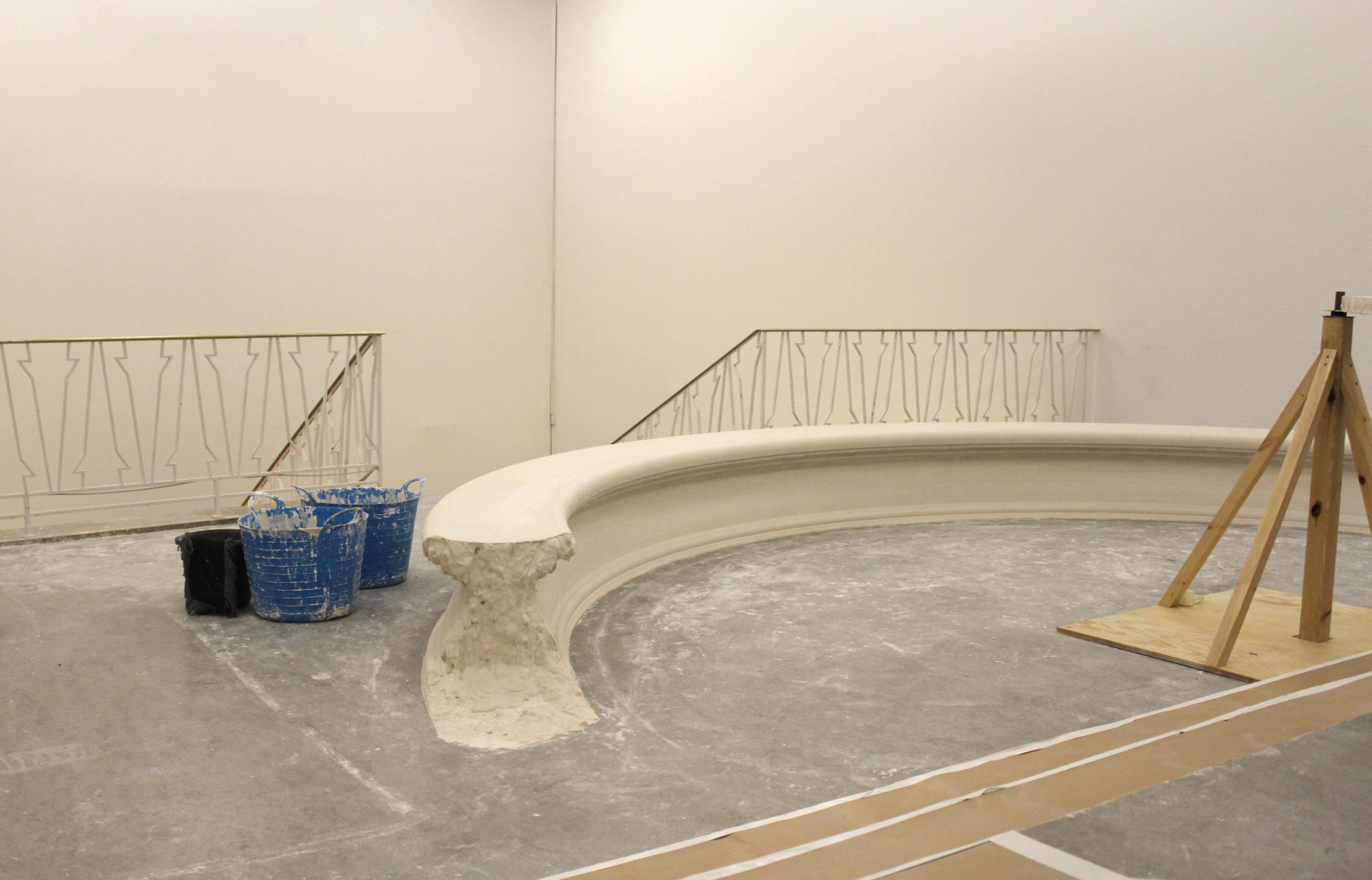A finished plaster bench with the overspill of plaster visible