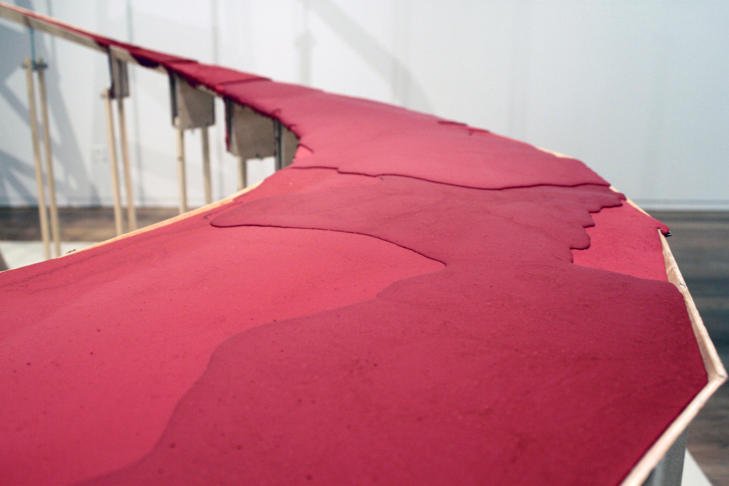 A detail of the red poly-concrete set hard like lava