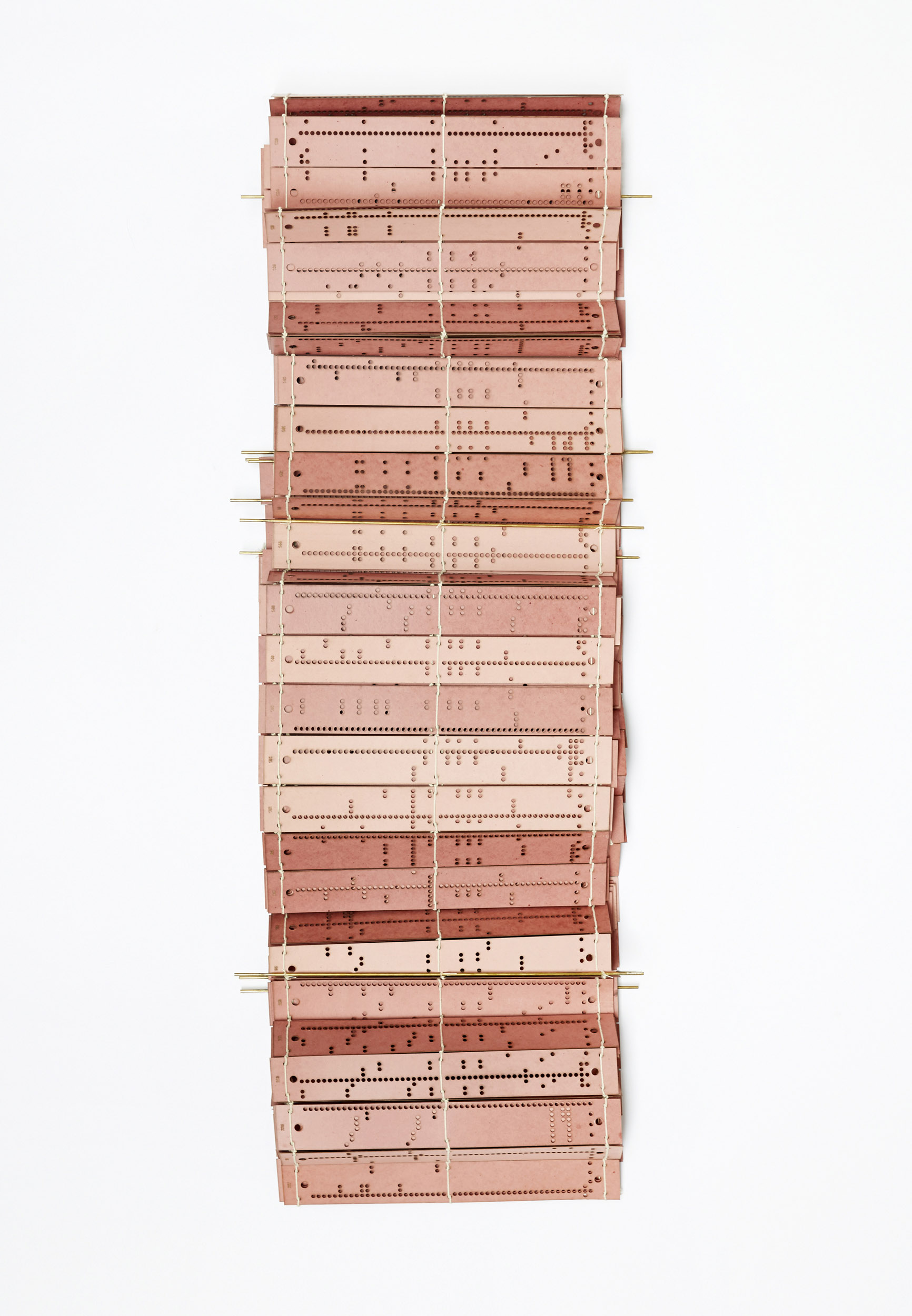 A weaving book of punched cards used for a Jacquard Loom