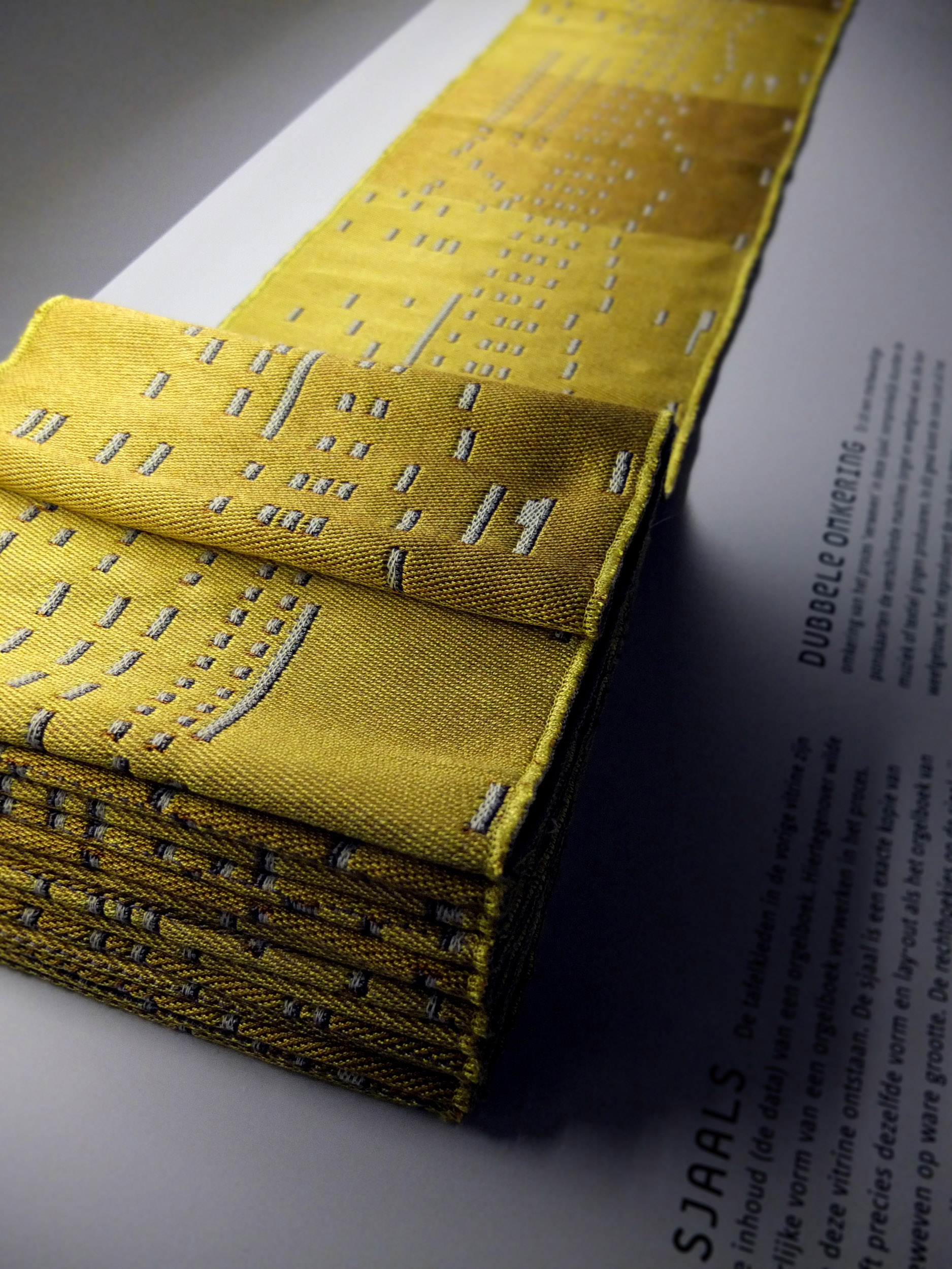 Silk scarves woven in the format of an organ book