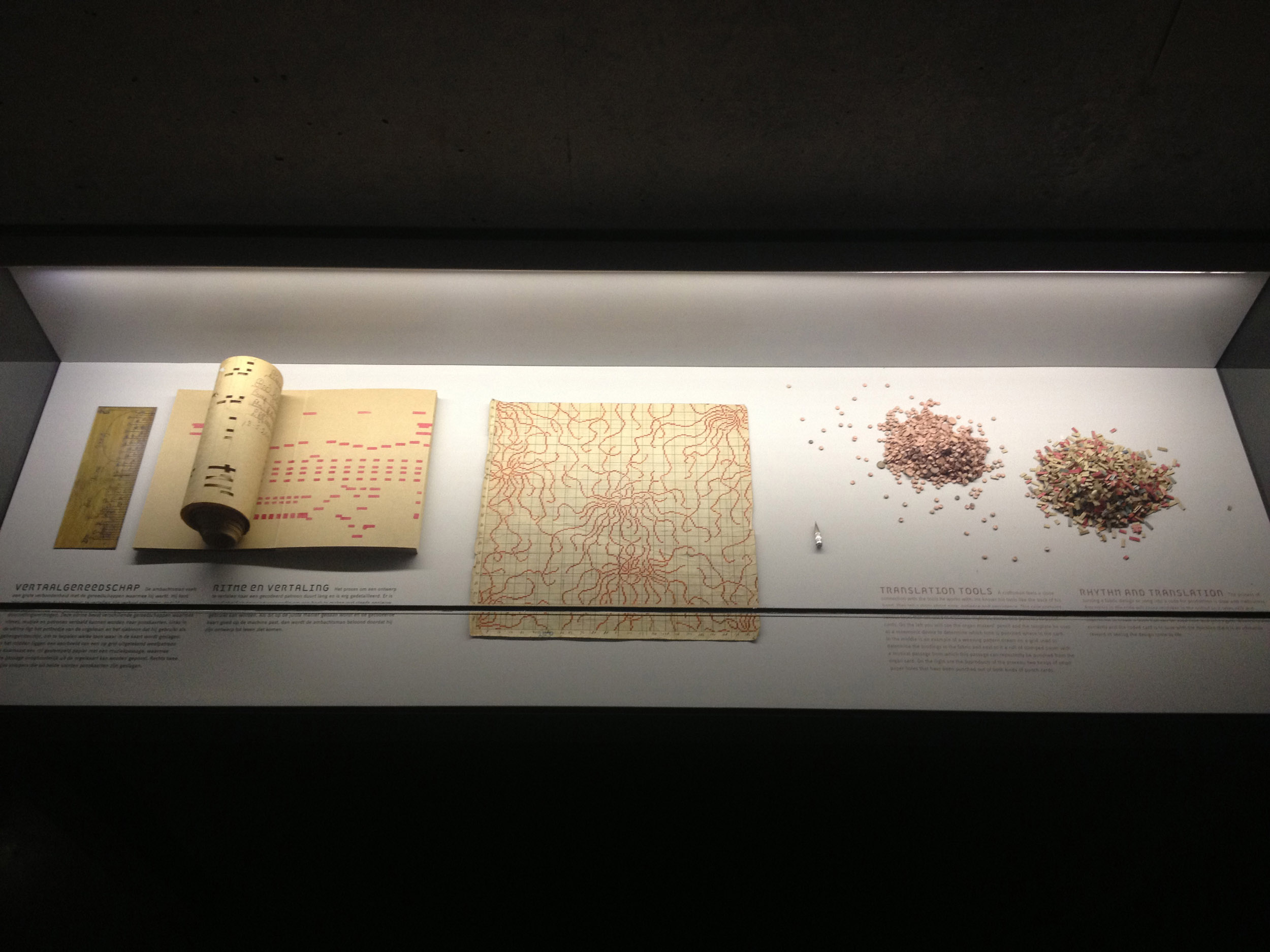 A vitrine containing artefacts of the project, including punching tools