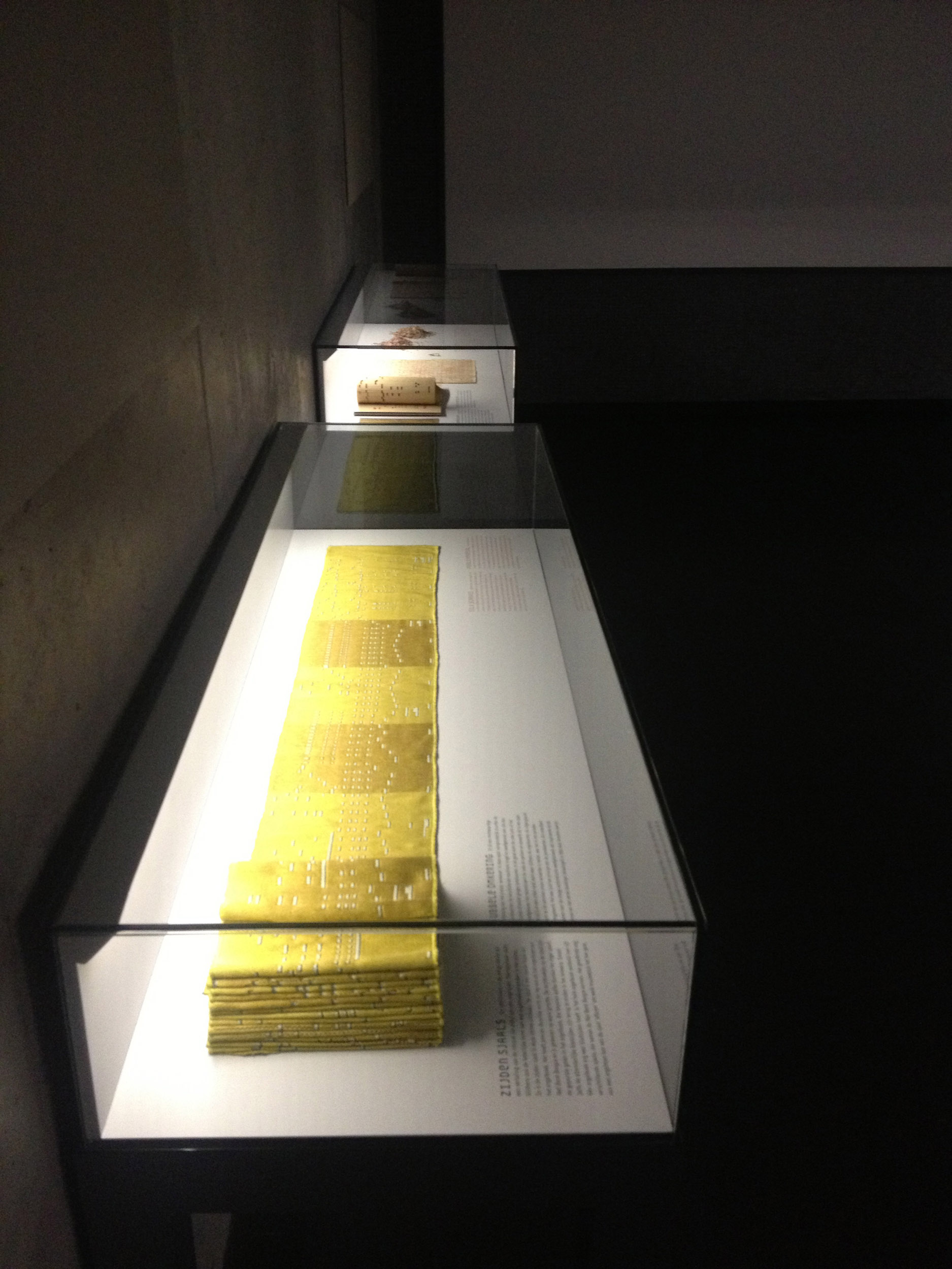 A vitrine containing silk scarves made for the exhibition