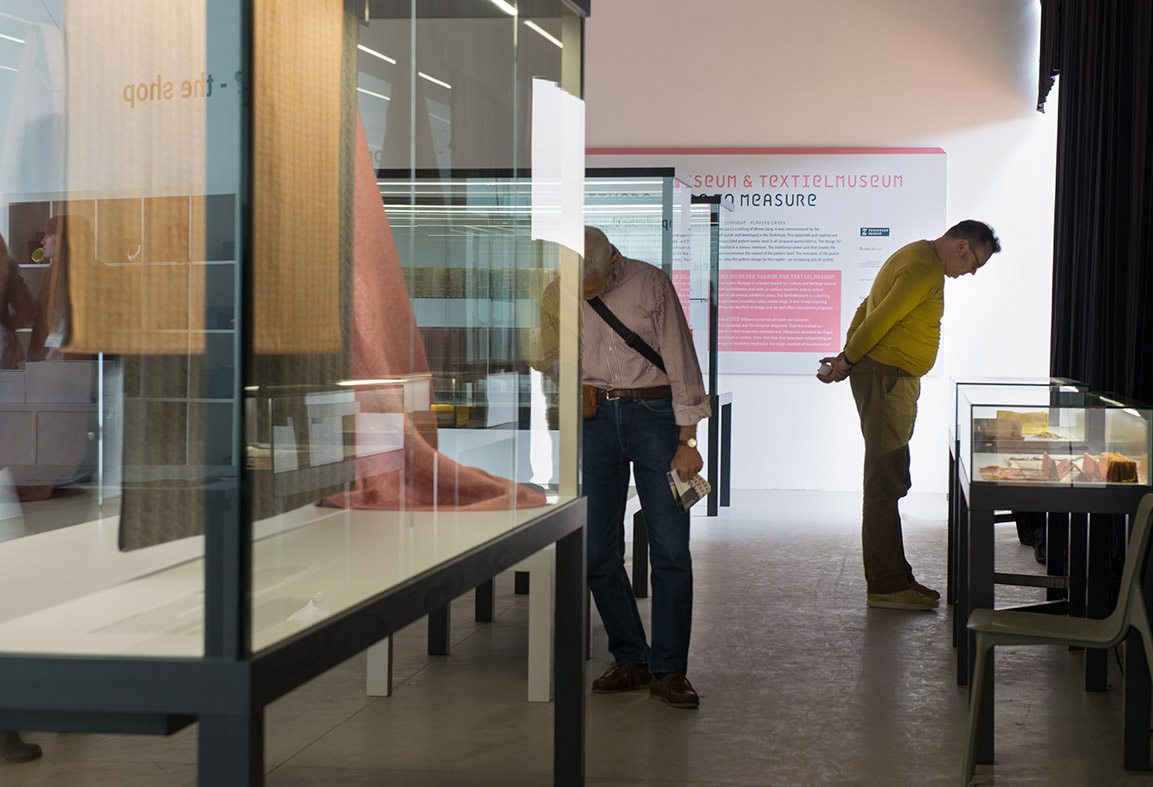 Visitors browsing artefacts of the exhibition