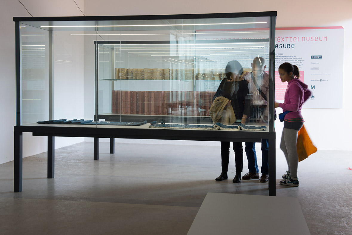 Visitors browse one the exhibition's custom vitrines
