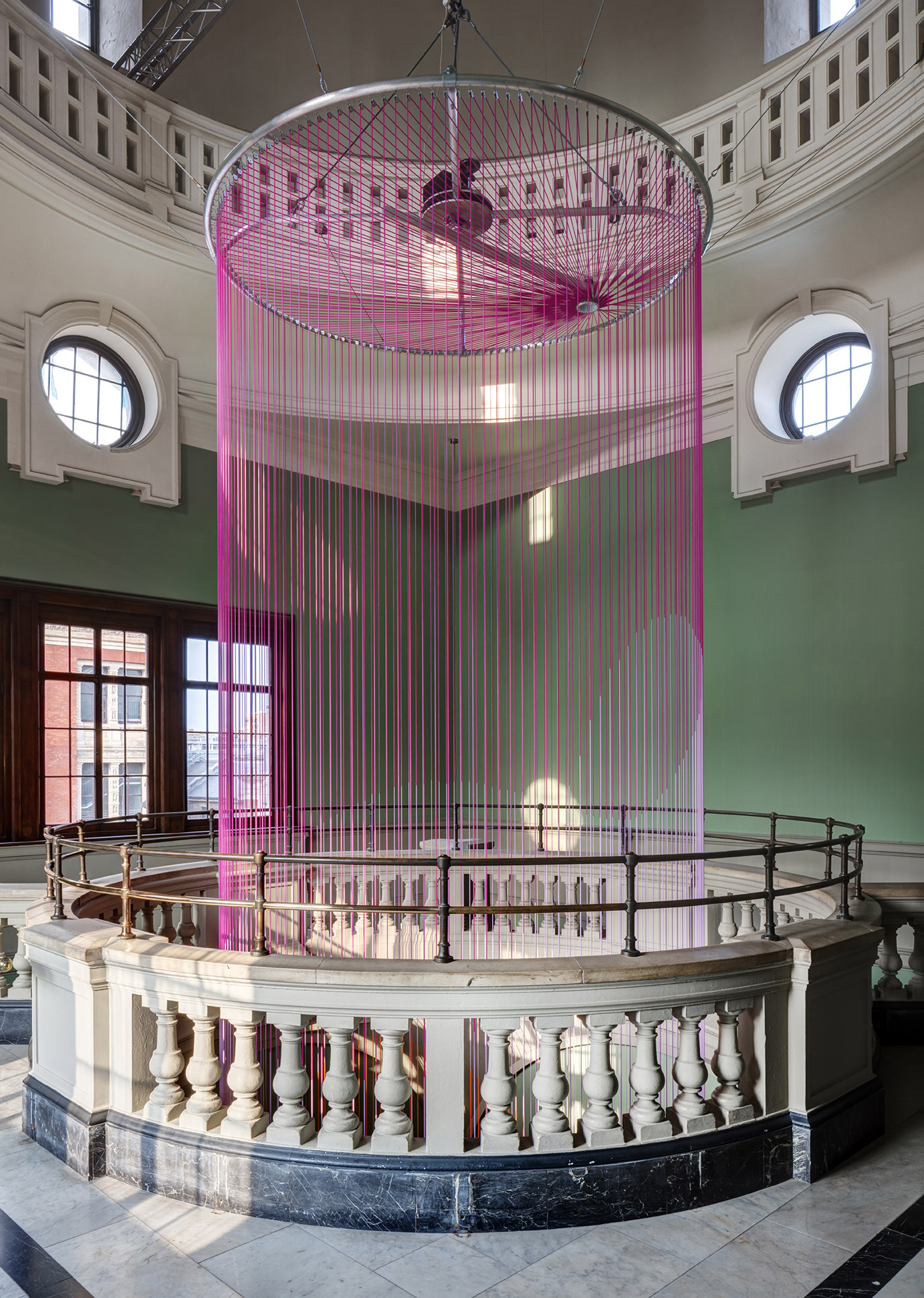 View of Green Rooms mechanical arm from top floor balcony of Victoria and Albert Museum