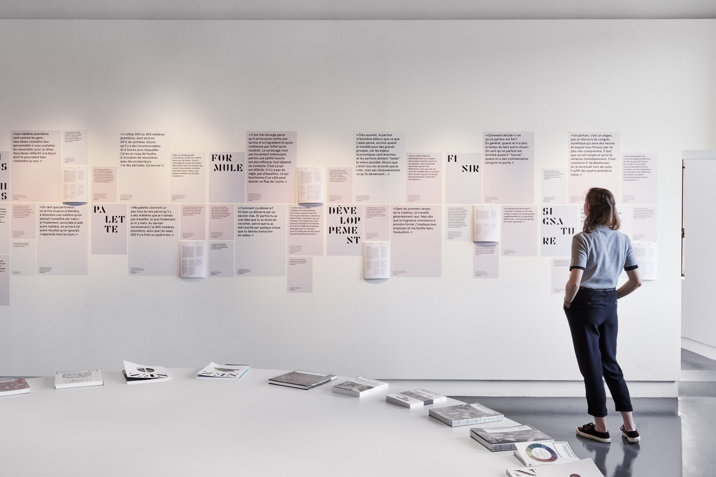 A visitor reads exhibition information texts