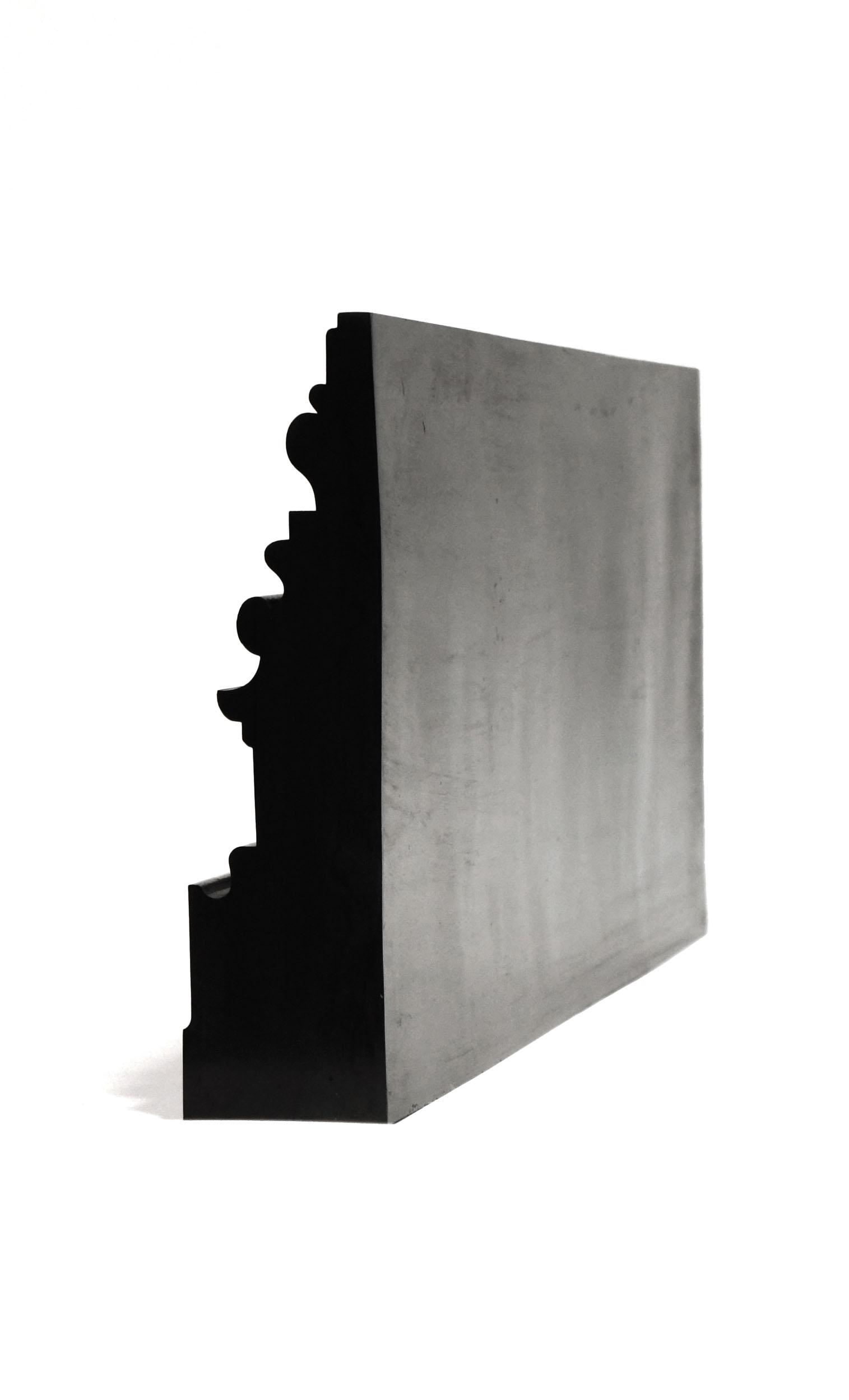 A black Bench Mould shelf on its back showing end profile