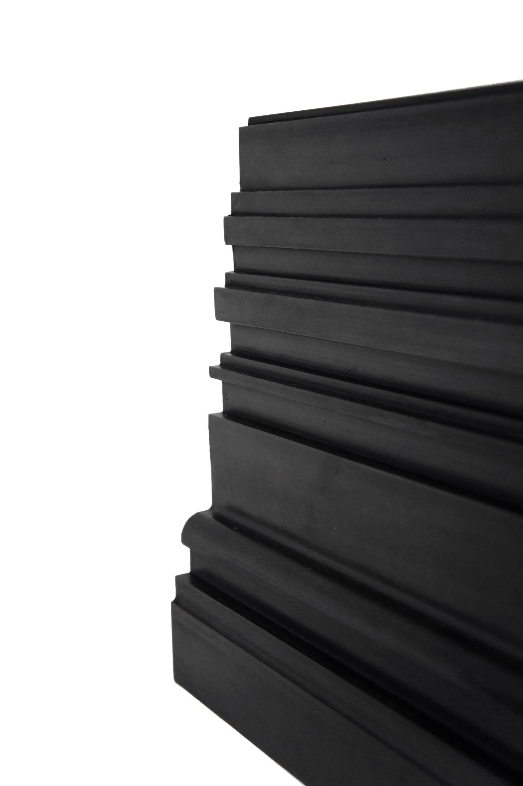 A black Bench Mould shelf in linear profile