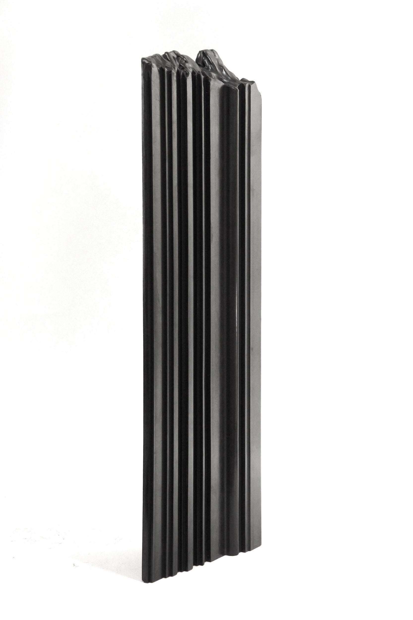 A black Bench Mould shelf stood on it's end showing ran edge