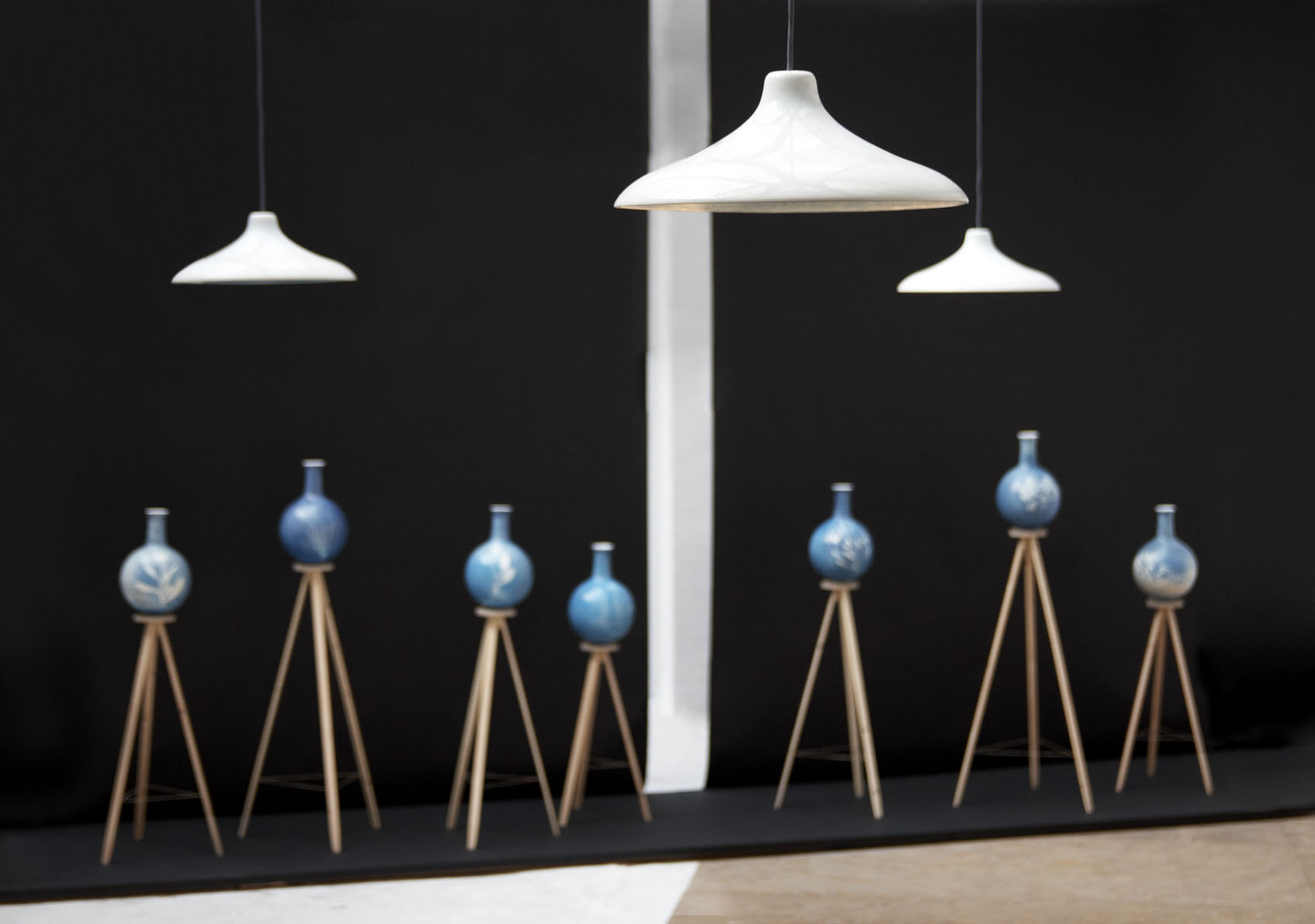 A presentation of Blueware lampshades above Blueware vases