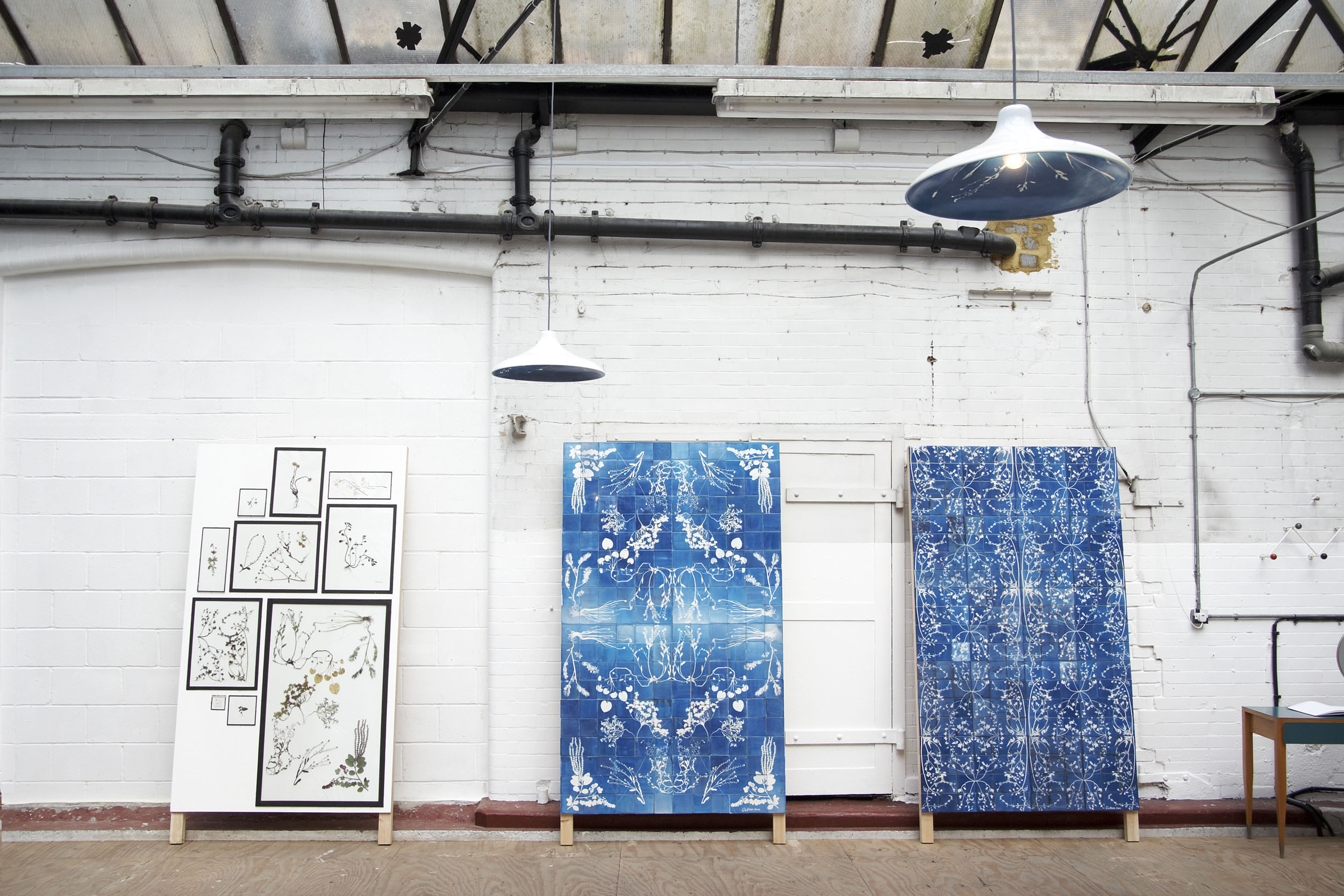 A presentation of Blueware tiles exhibited at Brompton Design week including glass plates with specimen
