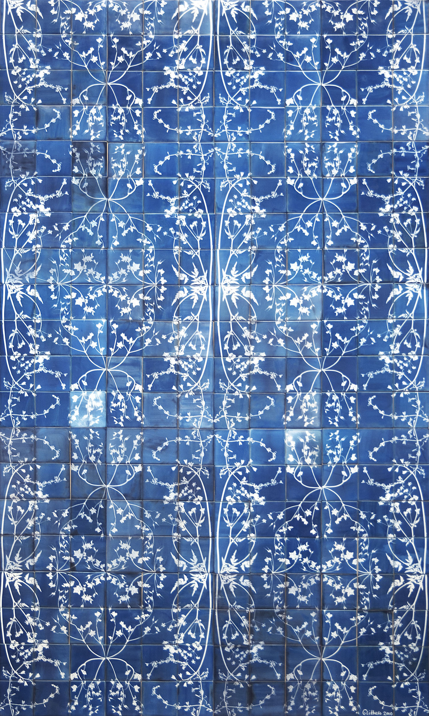 A Blueware tile mural with cyanotype photograms of pressed weeds with 5 lines of symmetry
