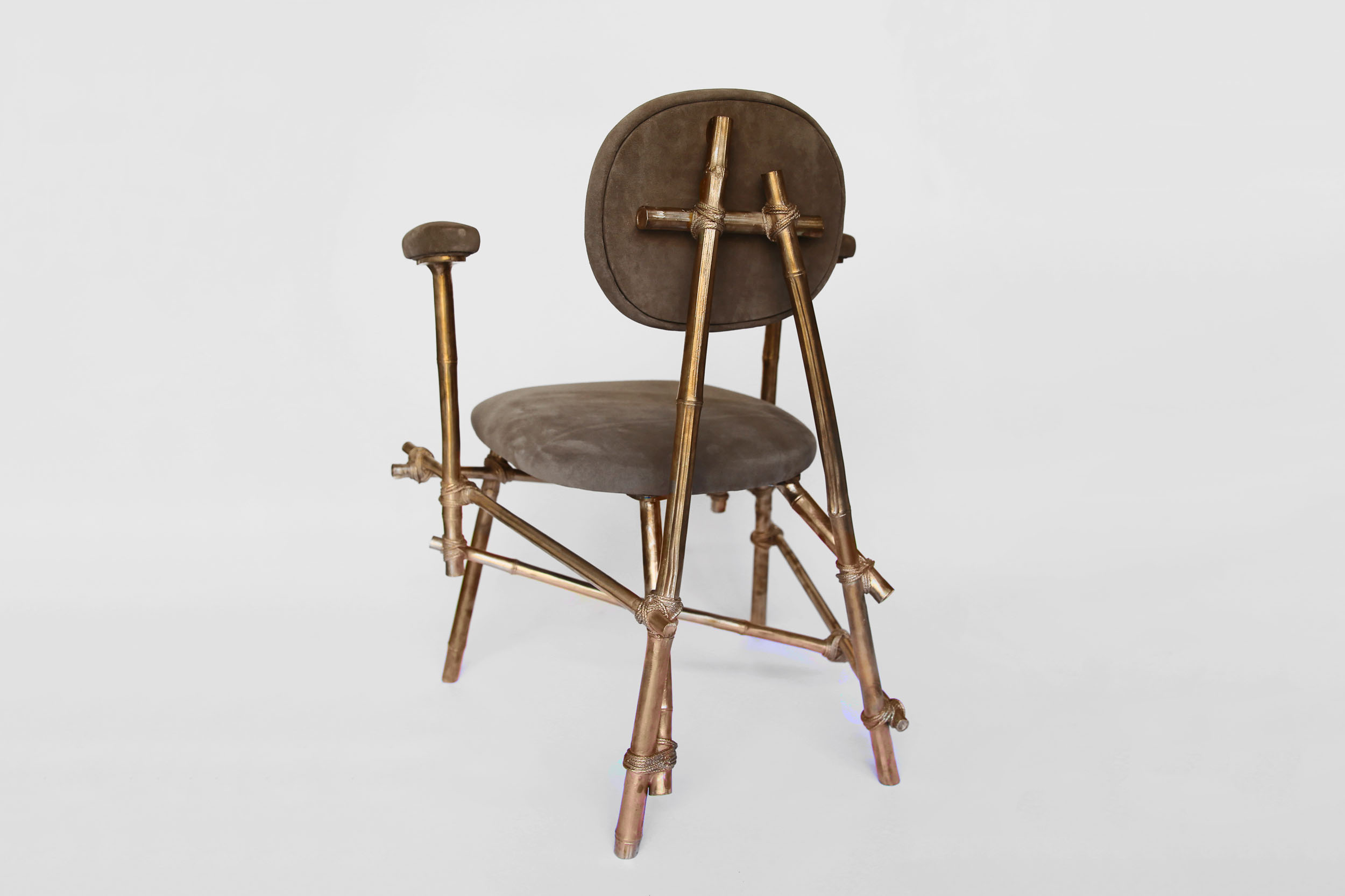 A back view of a Les French chair with bronze cast bamboo frame and leather upholstered seat and rests