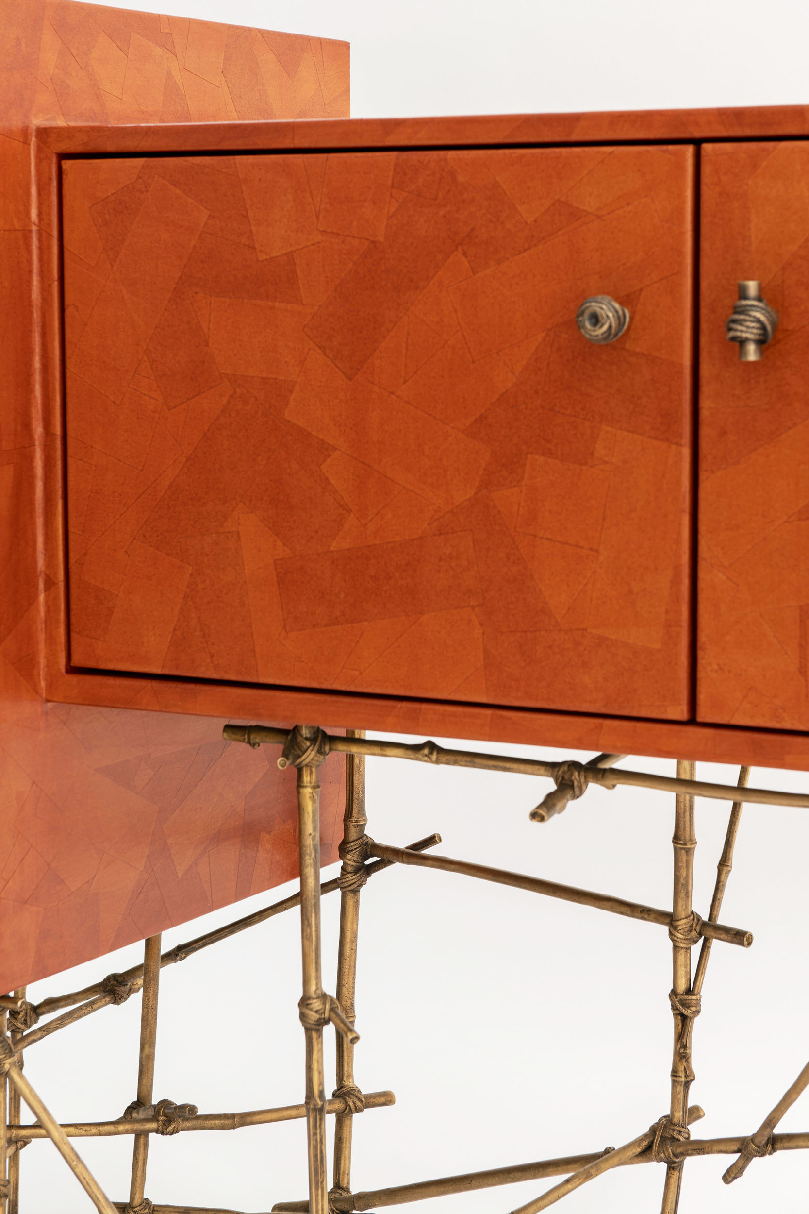 Detail of Je Na Sais Quoi console with burnt orange gum paper finish