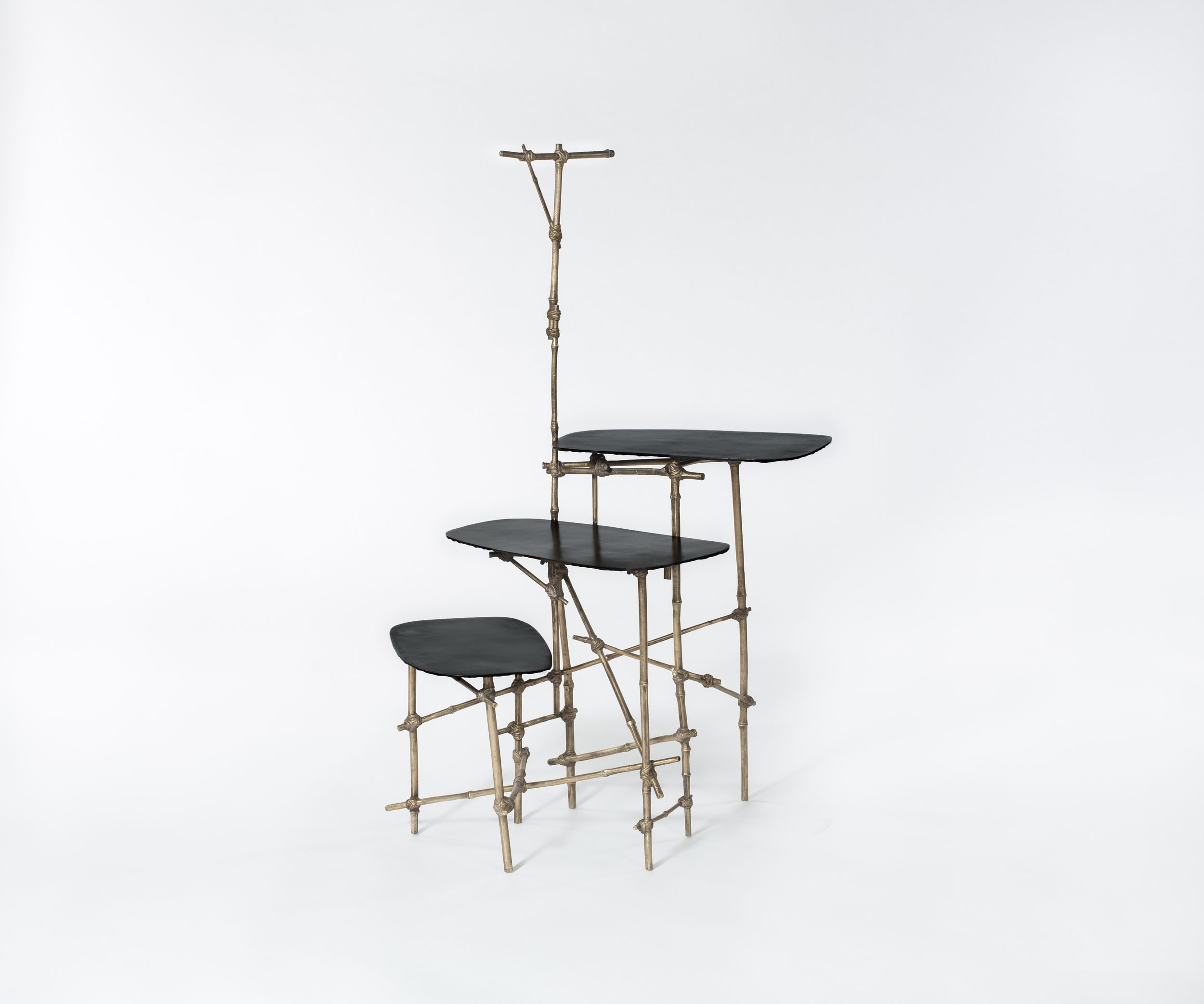 Tout de Suite furniture piece with bronze cast bamboo frame and staircase shelves