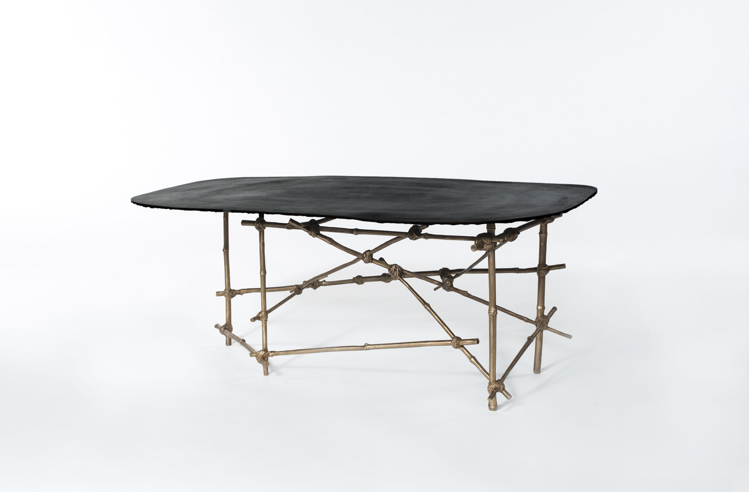 Mise en Place coffee table with bronze cast bamboo frame and patina surface