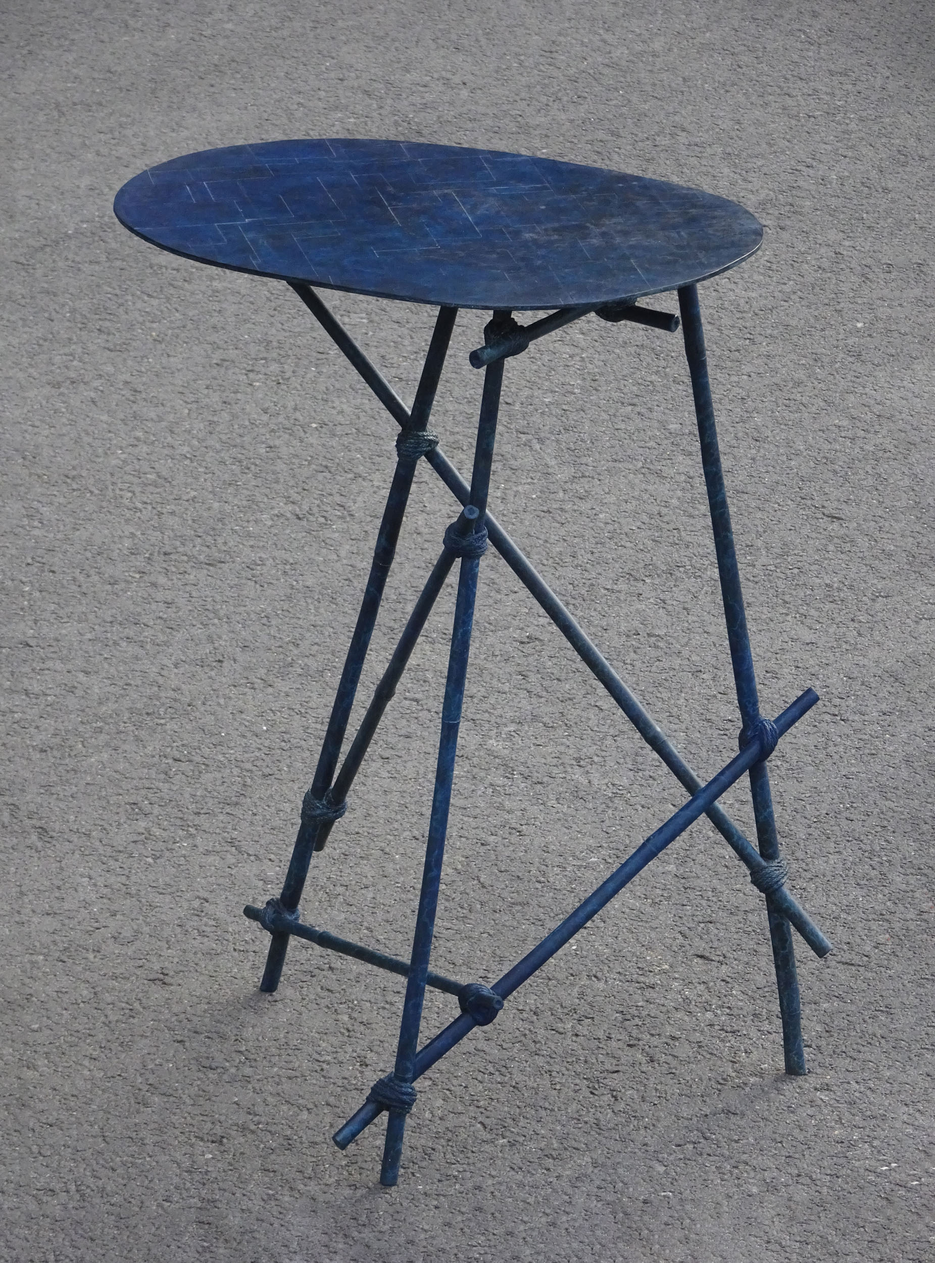 En Route side table with bronze cast bamboo frame in blue patina