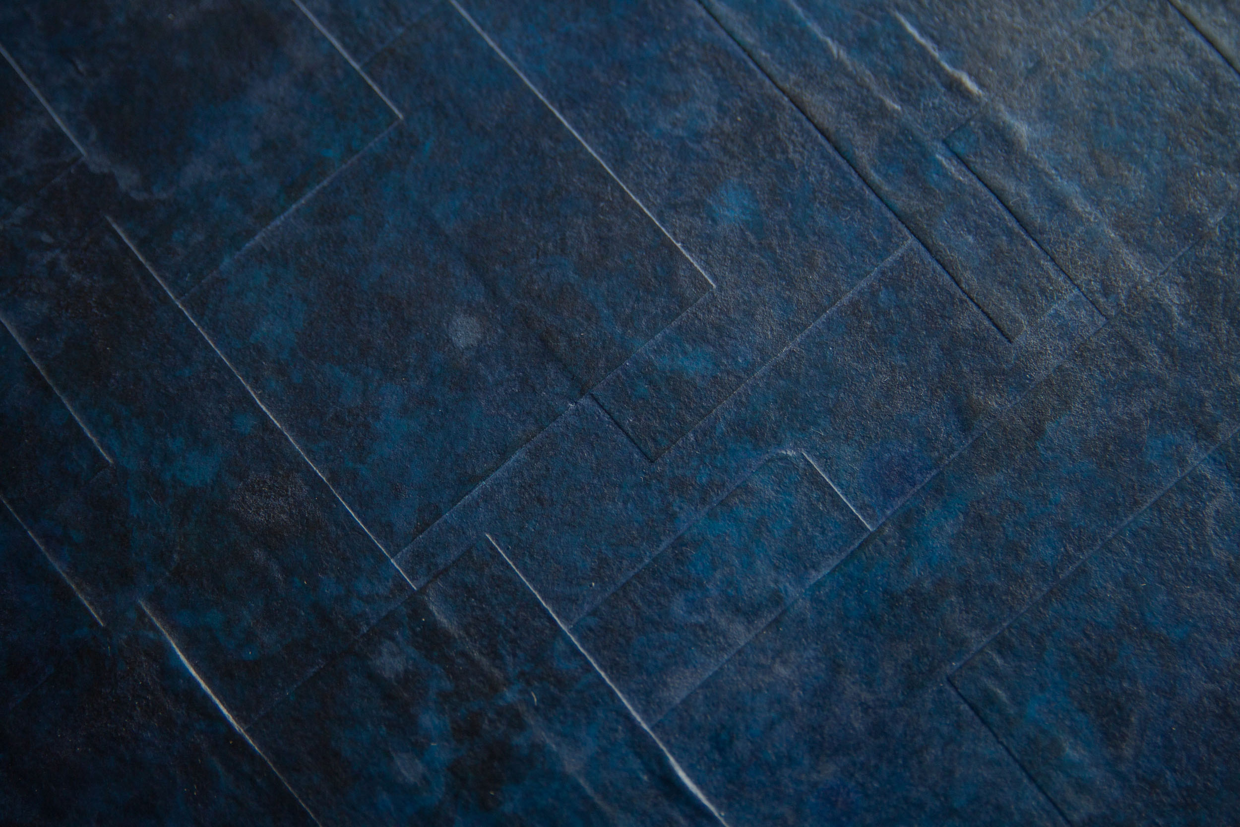 Detail of blue patina and cast gum paper bronze texture