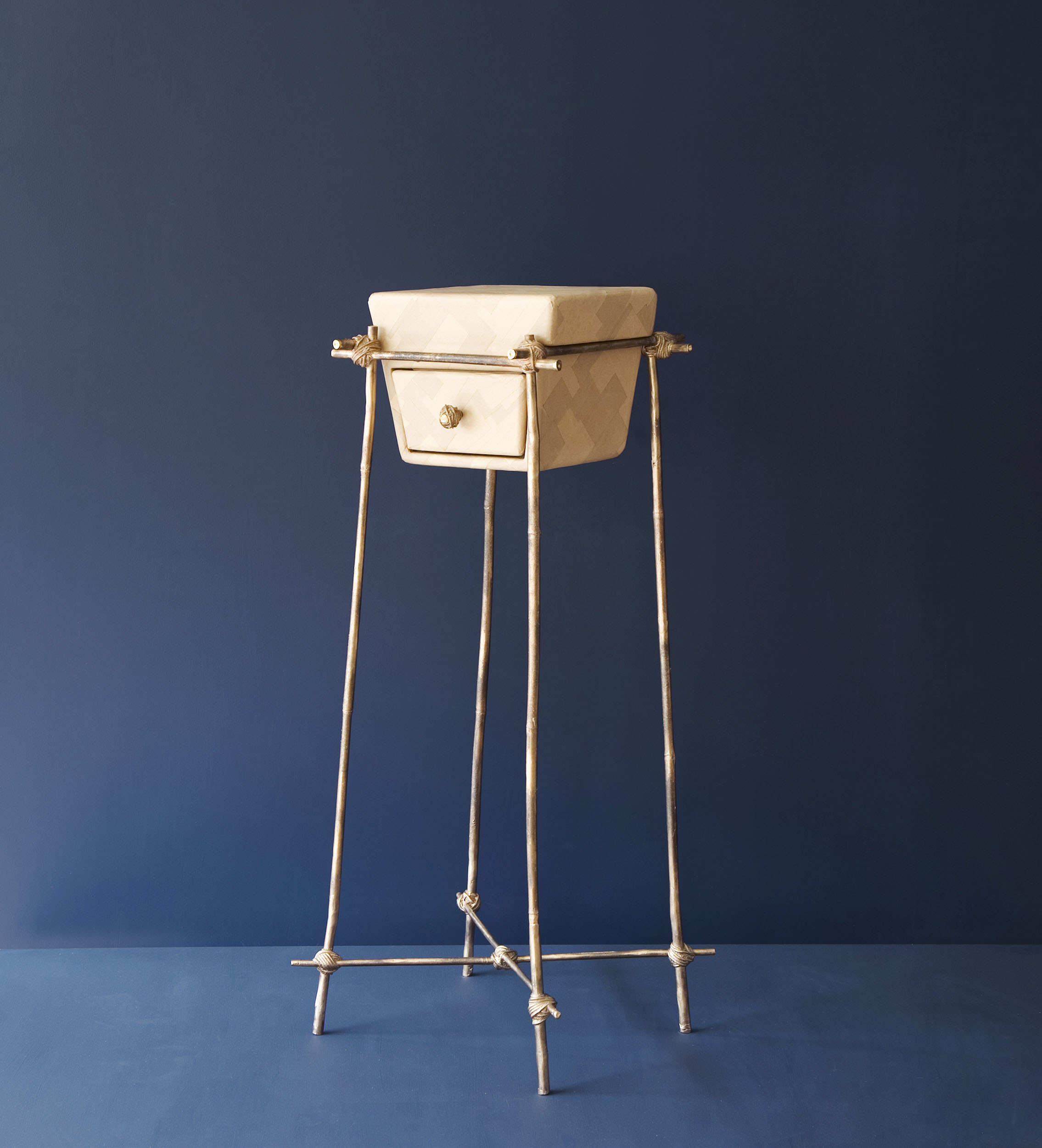 Les furniture piece with bronze cast bamboo frame and gum paper drawer
