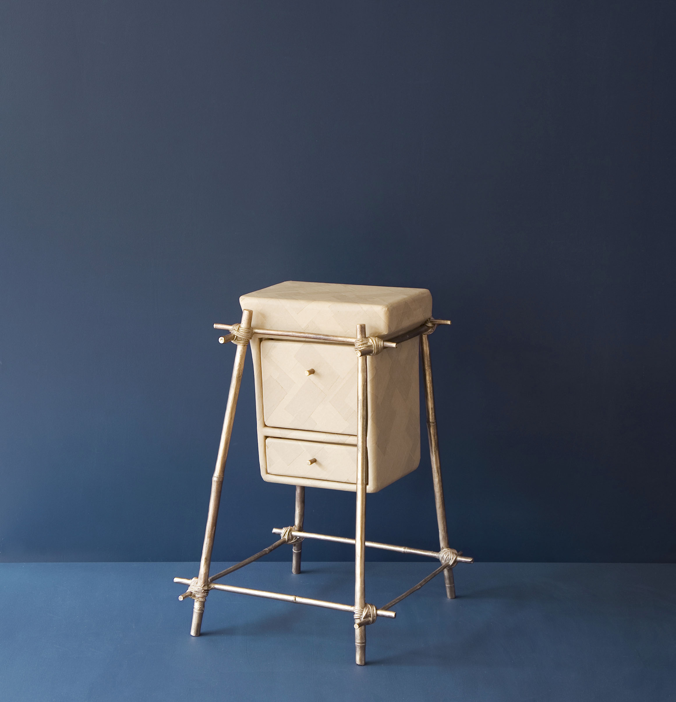 Laissez-faire furniture piece with bronze cast bamboo frame and gum paper drawers