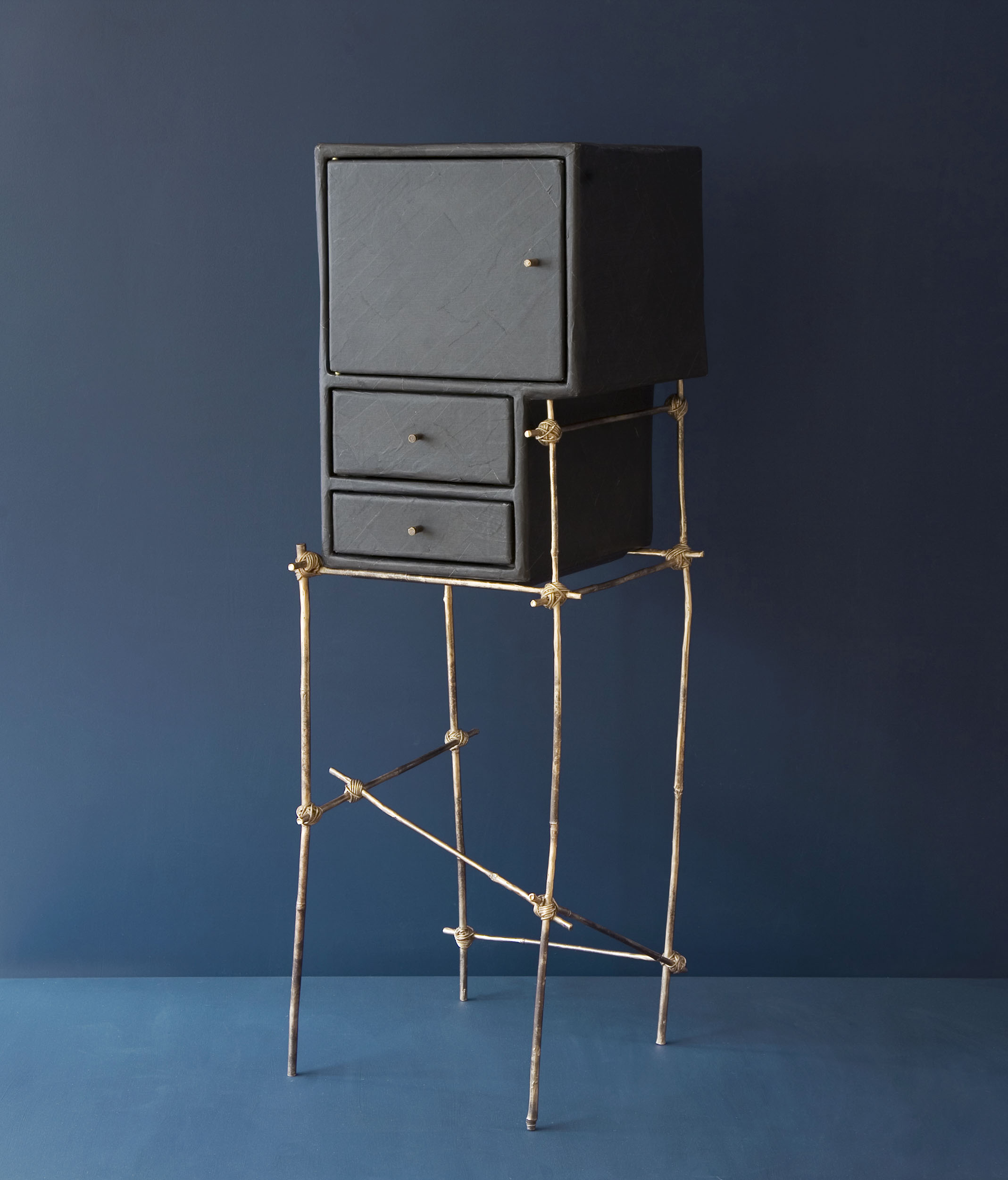 Menage a Trois furniture piece with bronze cast bamboo frame and gum paper cupboard