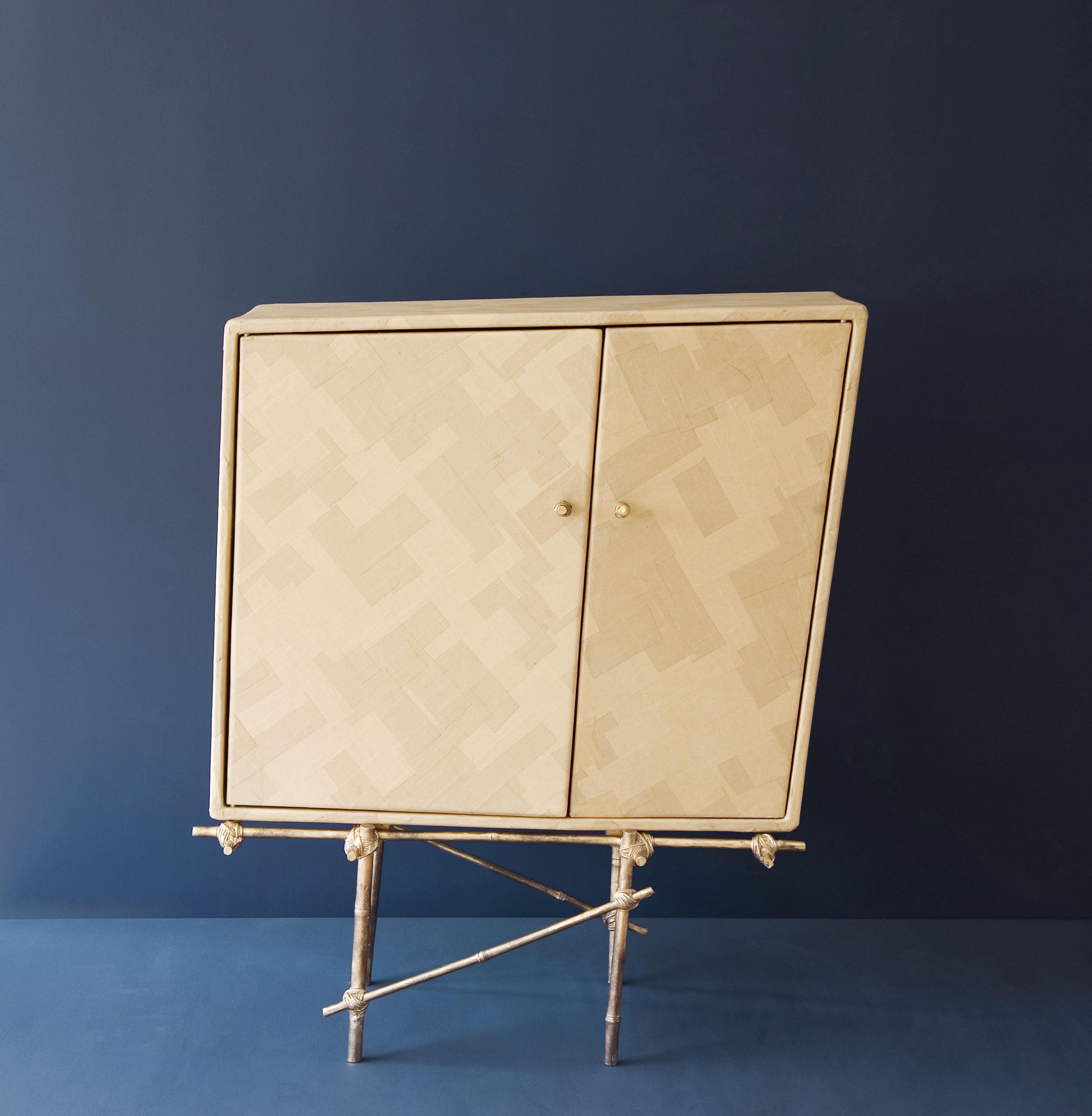 Deja-vu furniture piece with bronze cast bamboo frame and gum paper cupboard