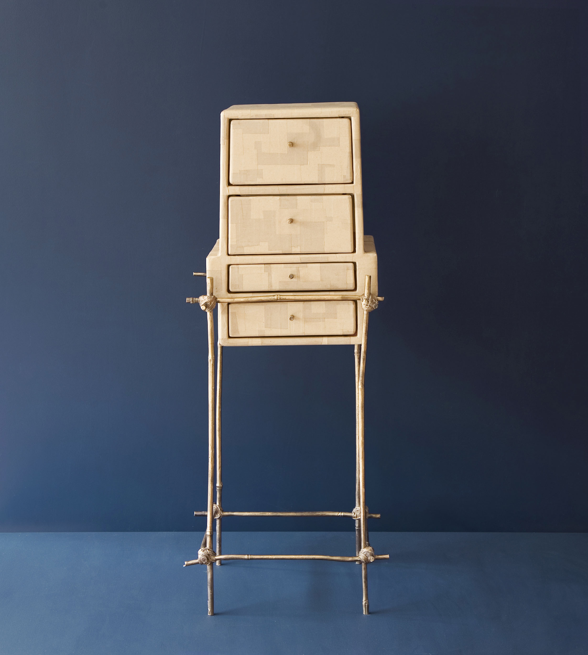 Petit Dejeuner furniture piece with bronze cast bamboo frame and gum paper drawers