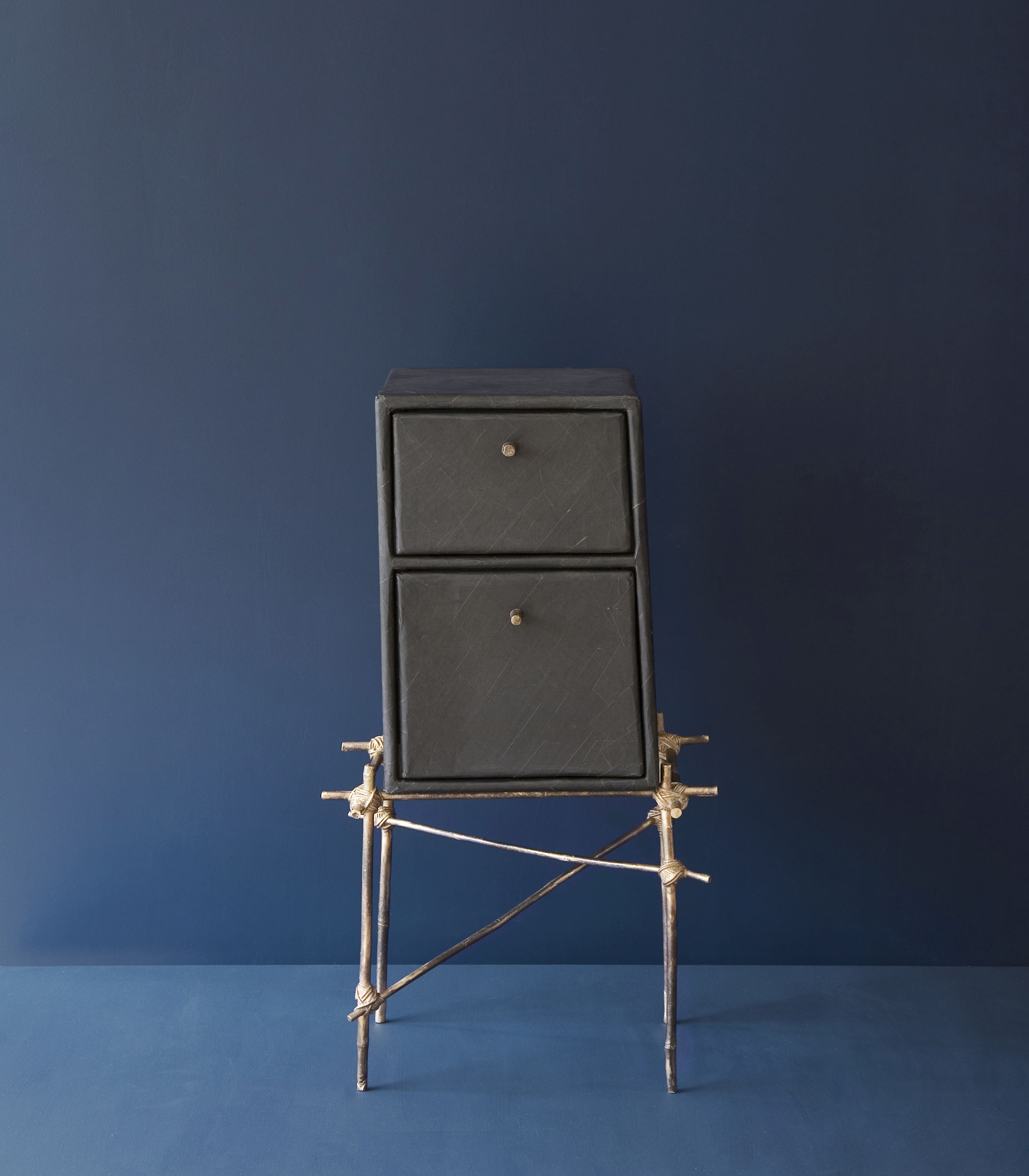 Enfant Terrible drawer unit with bronze cast bamboo frame and black gum paper drawers