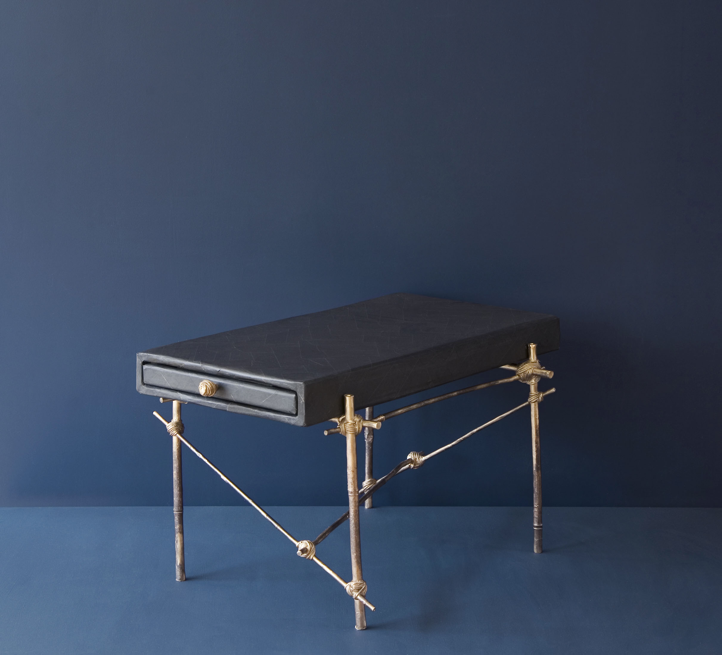 Mis en Place side table with bronze cast bamboo frame and black gum paper drawer unit