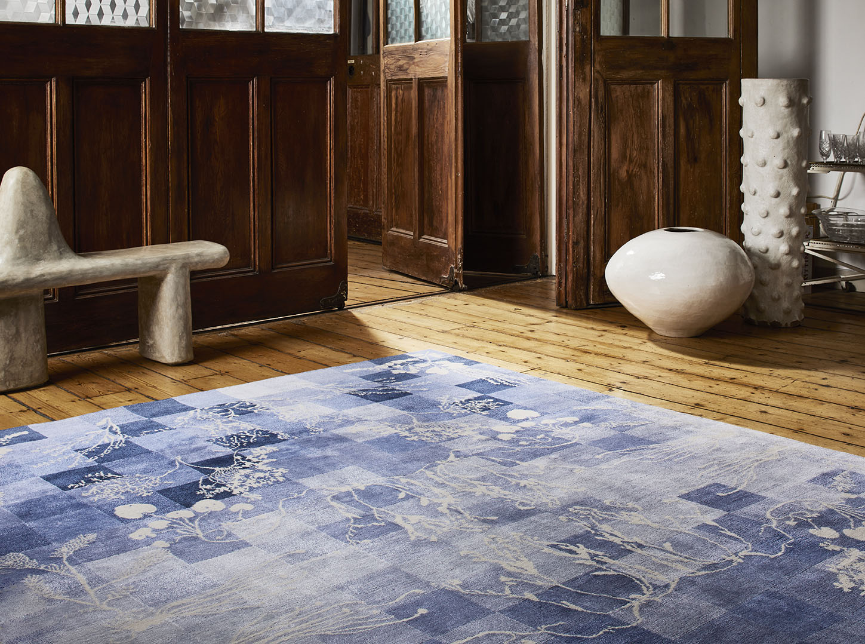 A blue Botanical rug in situ