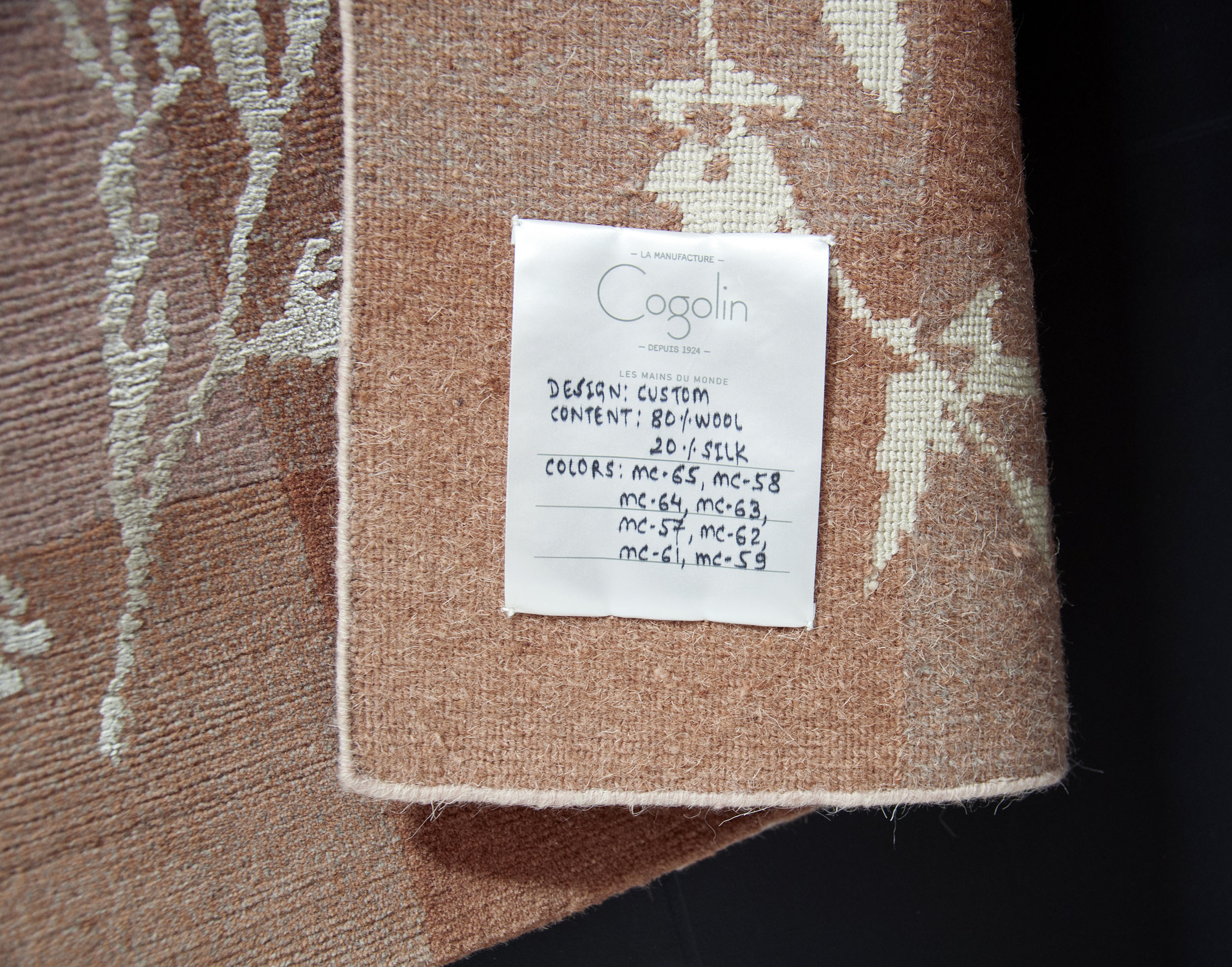 Detail of Botanical Rug label with material composition