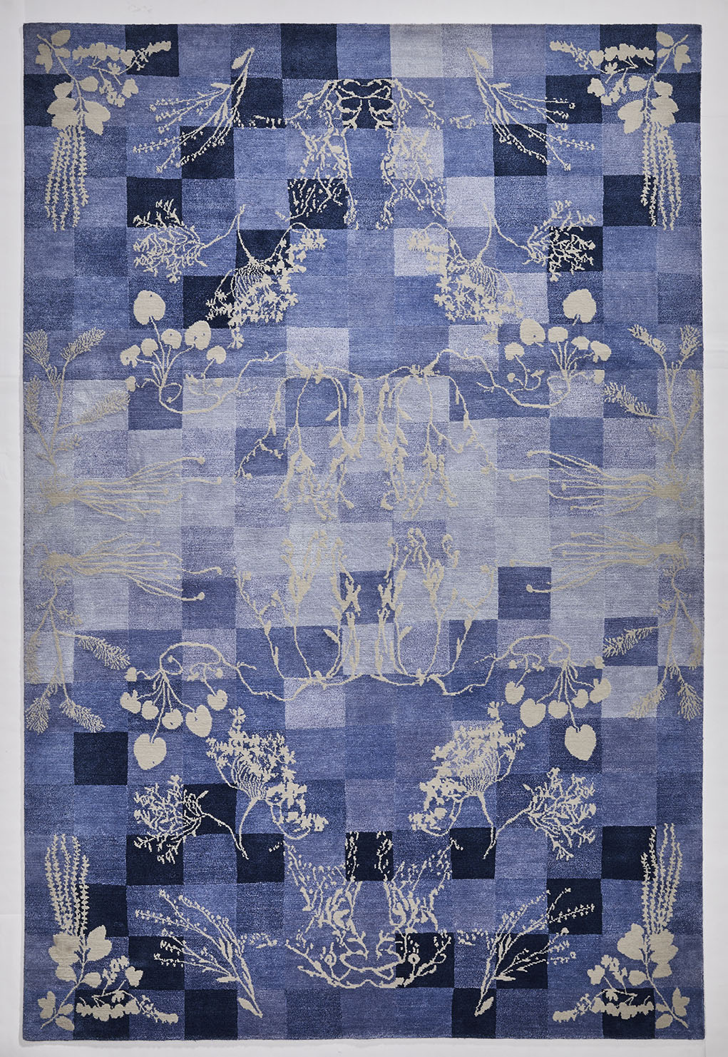 Overview of a blue colour Botanical Rug with floral weed design