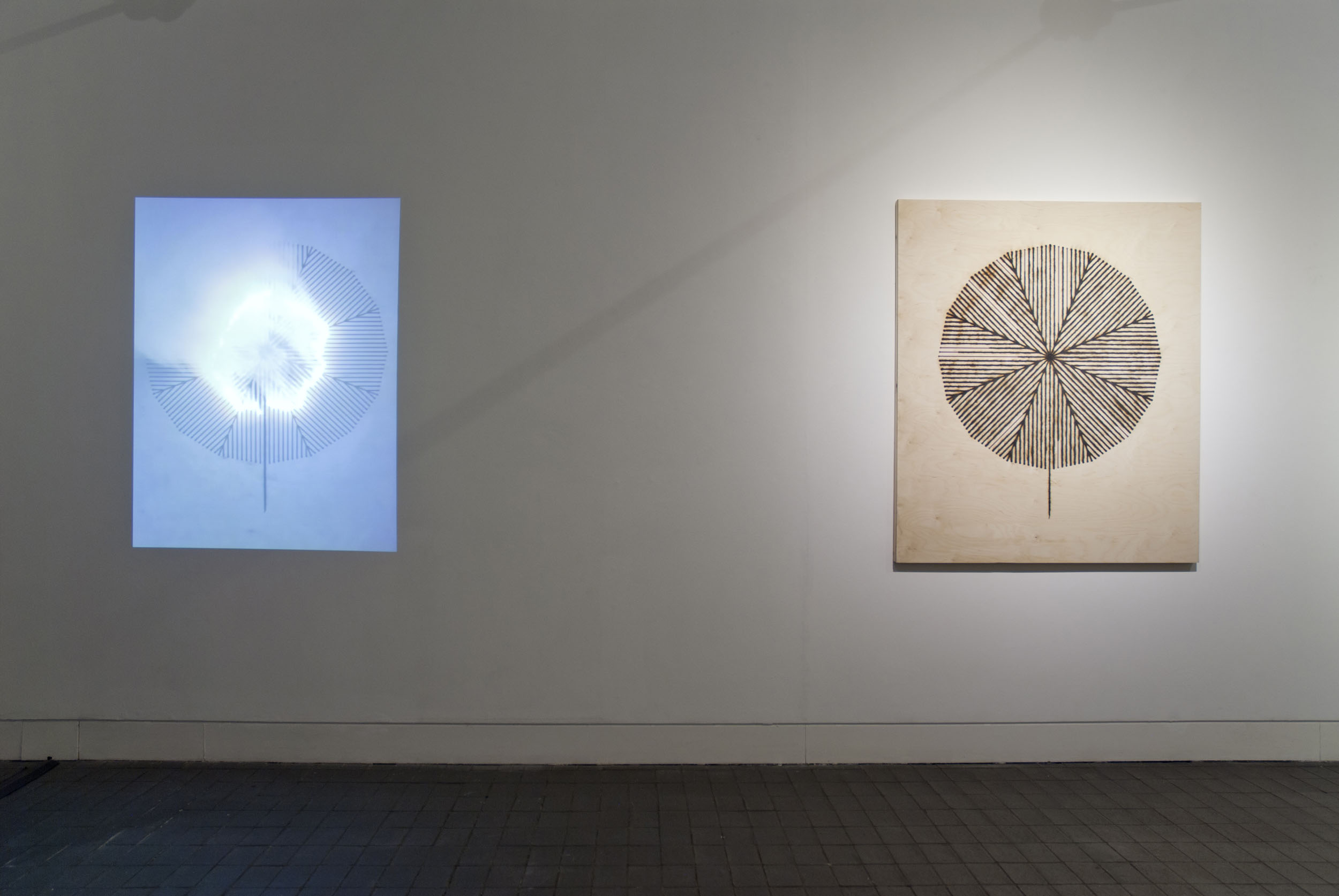 A photograph from Fire Drawings exhibition at the Jerwood Gallery of hung work and film