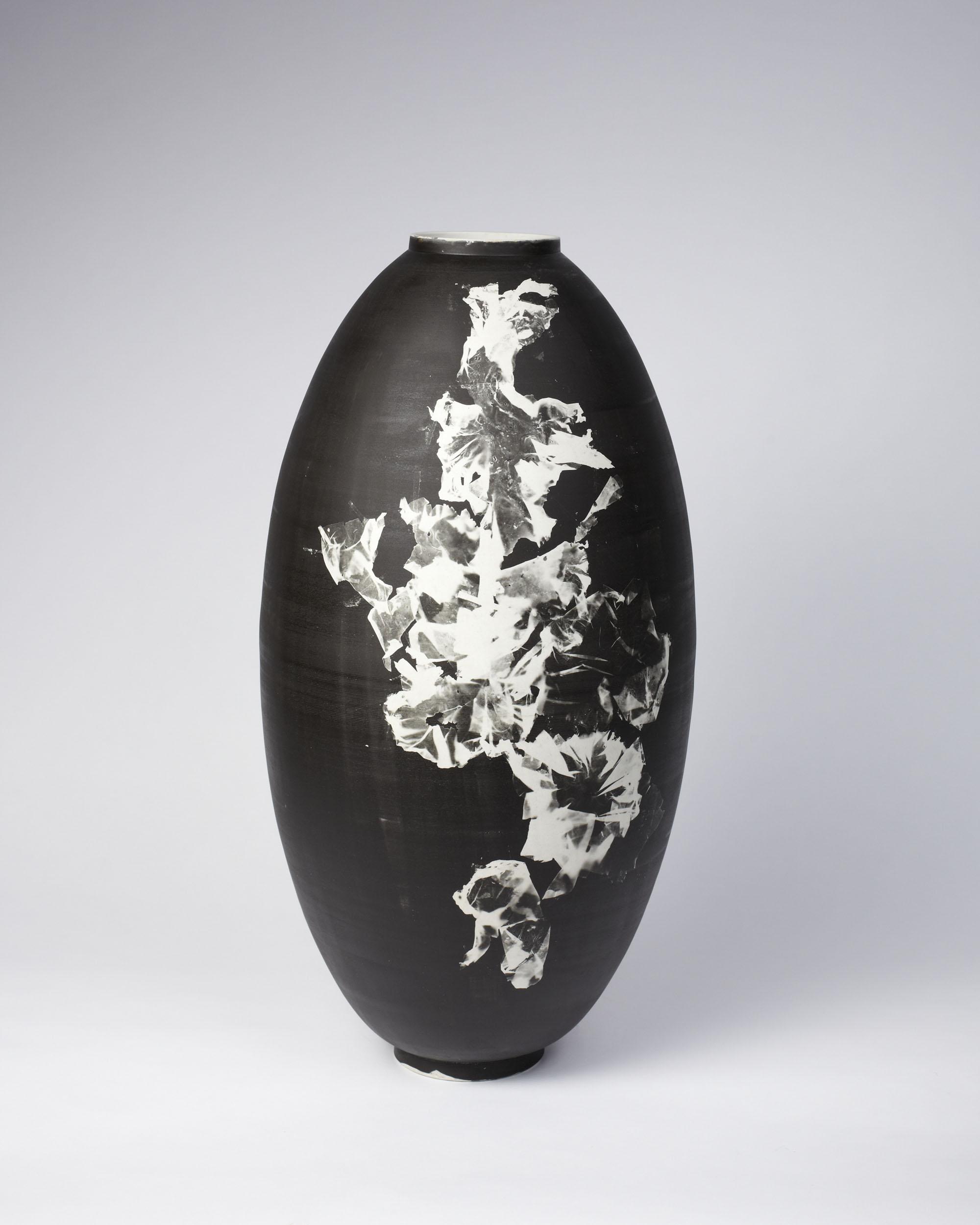 A tall Silverware vase with sea lettuce silver gelatin photogram