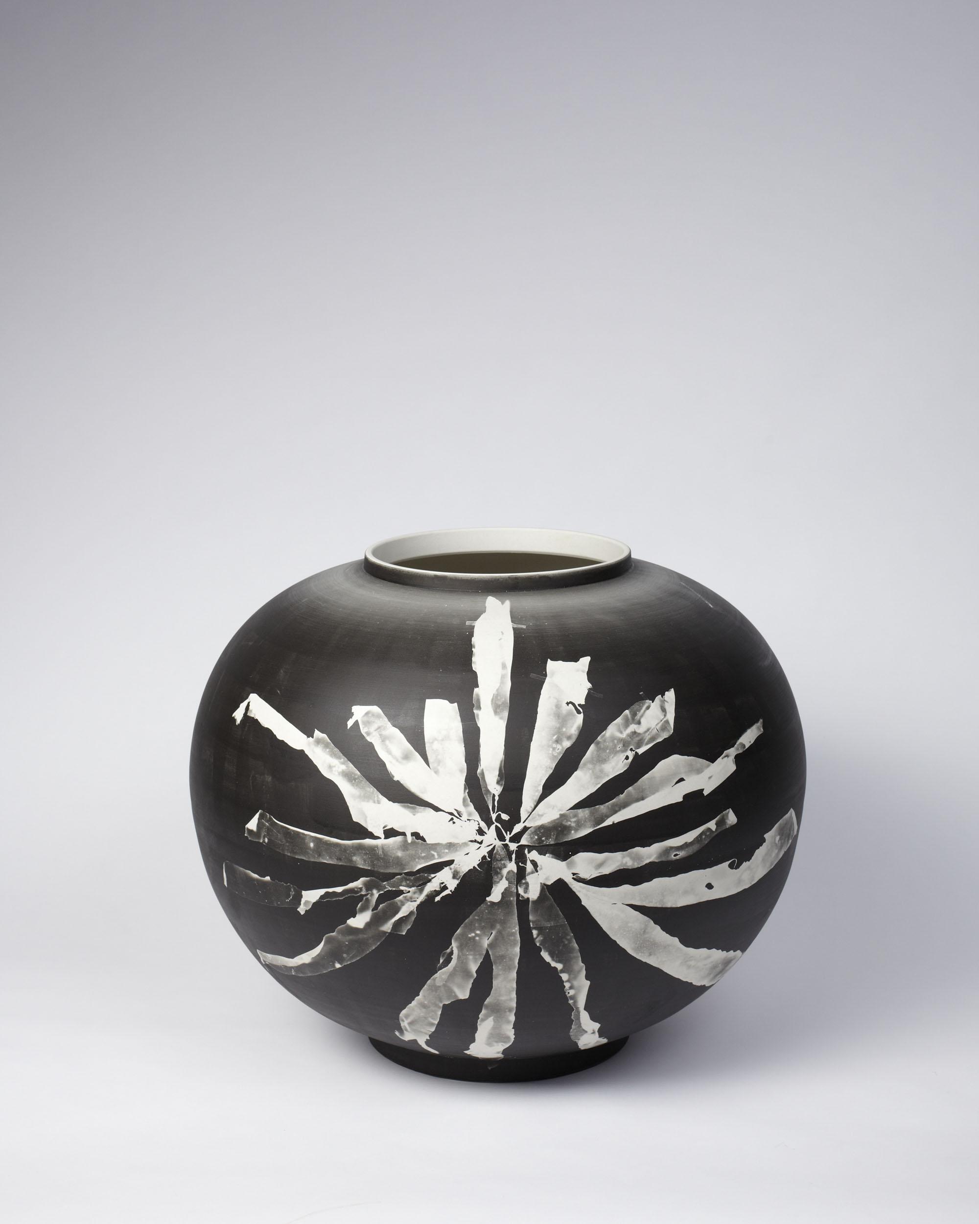 A round Silverware vase with silver gelatin photogram of foraged seaweed in spider composition