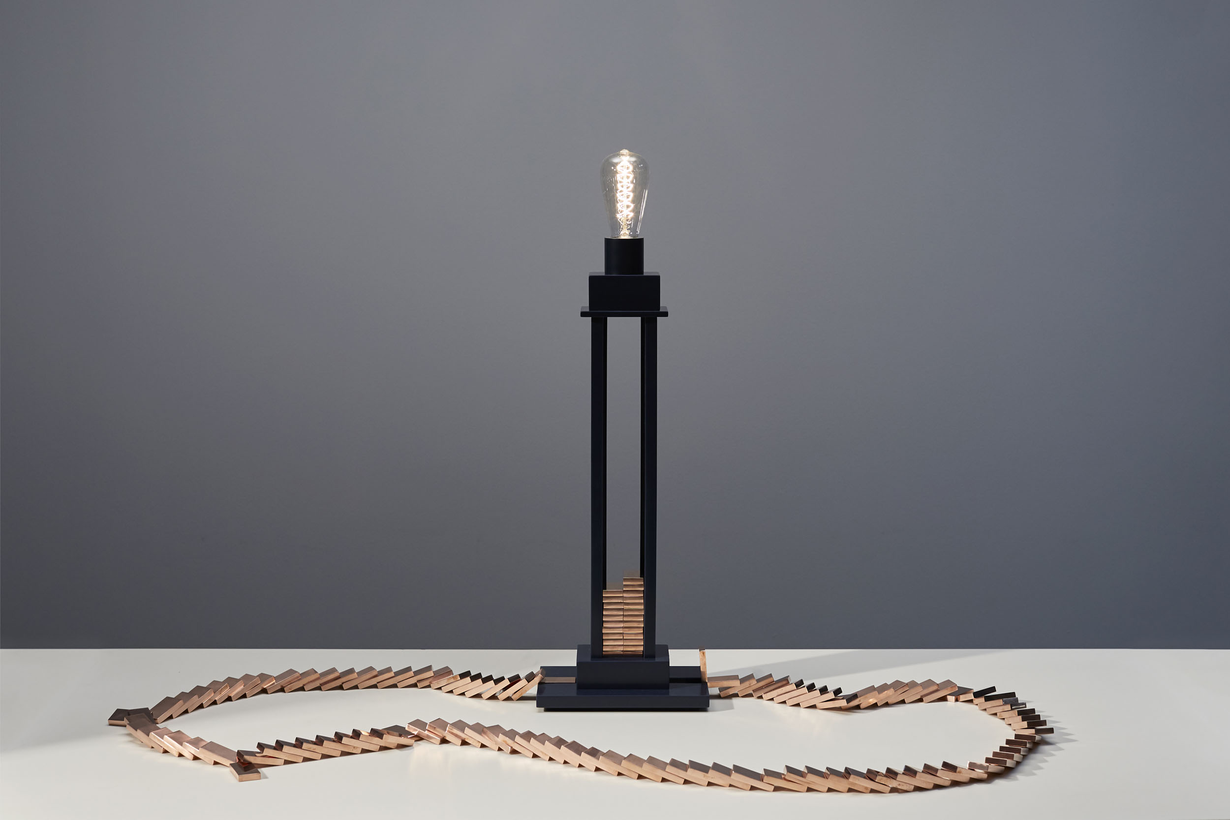 Domino Light switched on with collapsed dominos completing electrical circuit