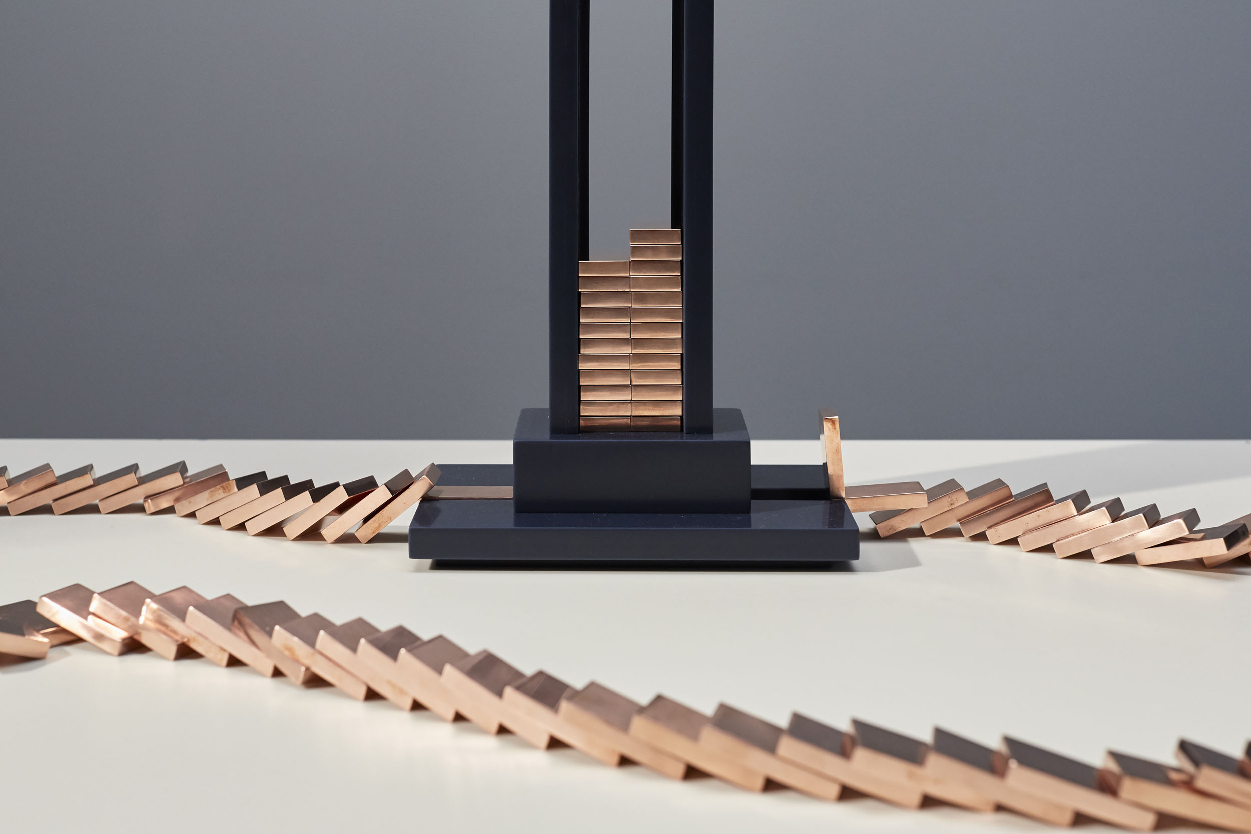 Detail of Domino Light base and collapsed copper dominos