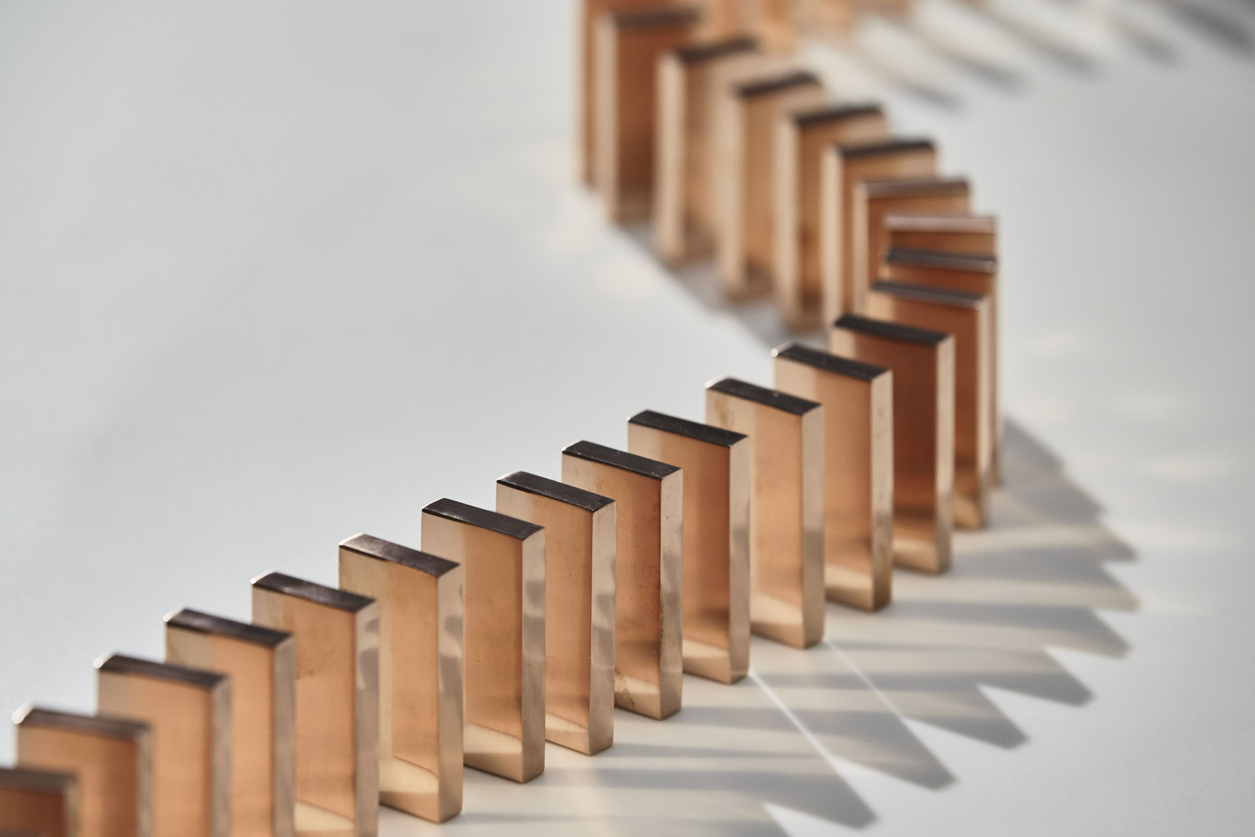 Detail copper dominos lined up