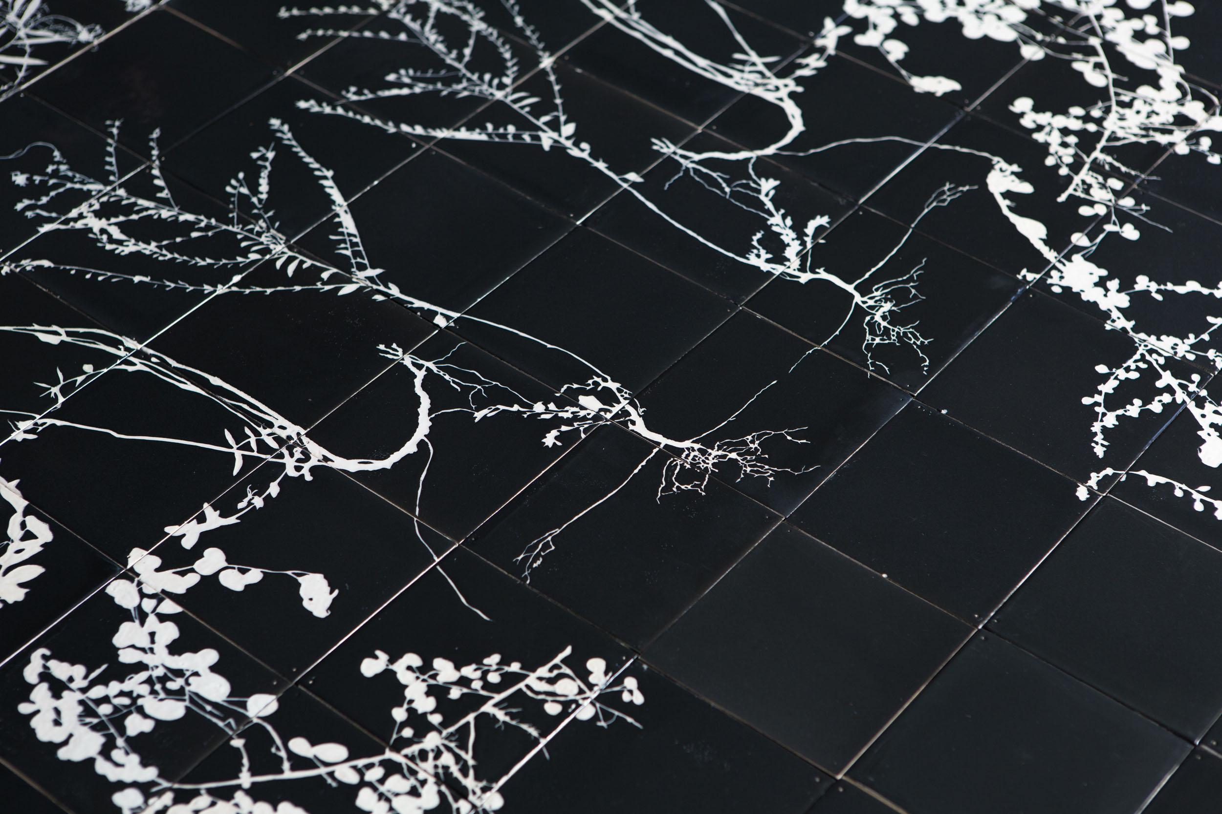 Details of Botanical Tile mural of weeds in black and white glaze