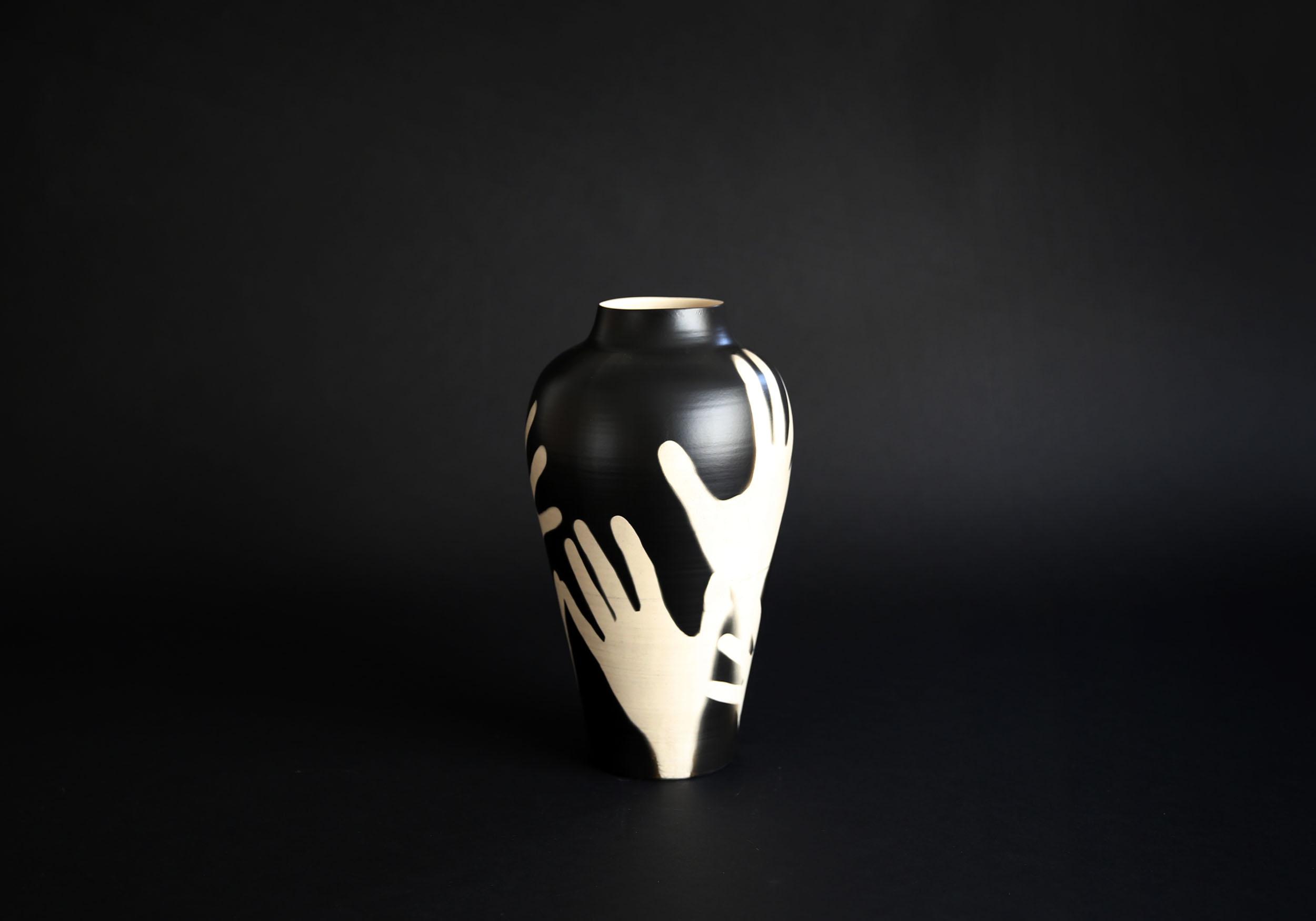 A Hold Me vase depicting hands