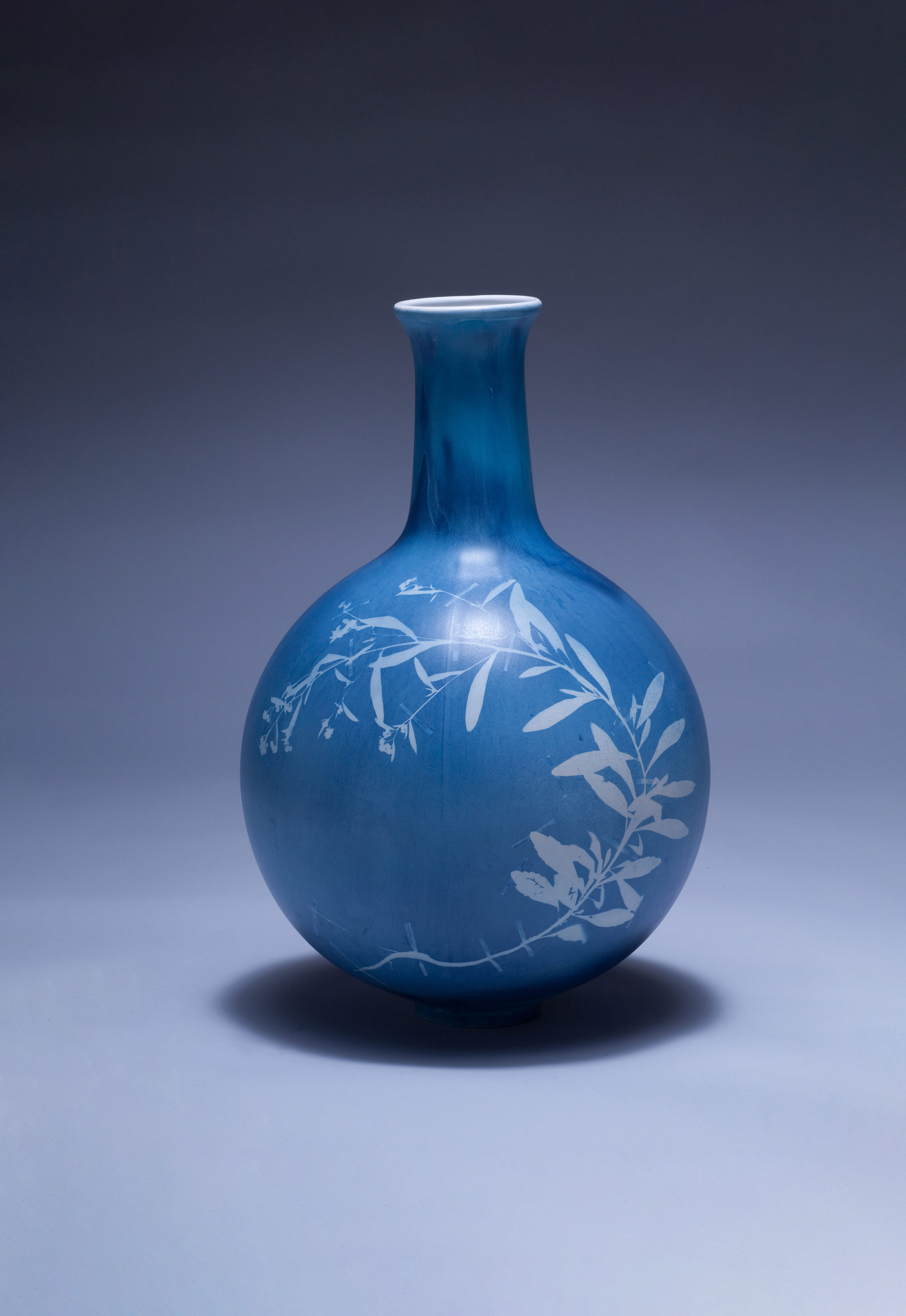 Blueware vases is a collection of vases with cyanotype photograms of foraged weeds. The weeds are pressed in our herbarium before being captured on the vases using an original photographic process.