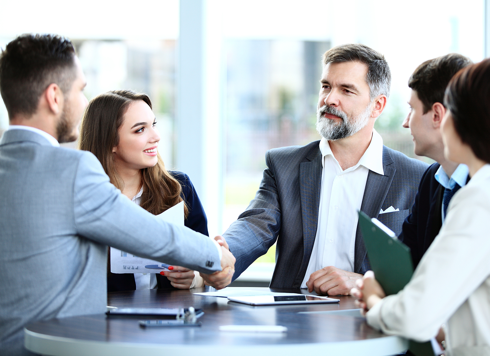 Investment Dealers: Representative image of wealth management professionals at work