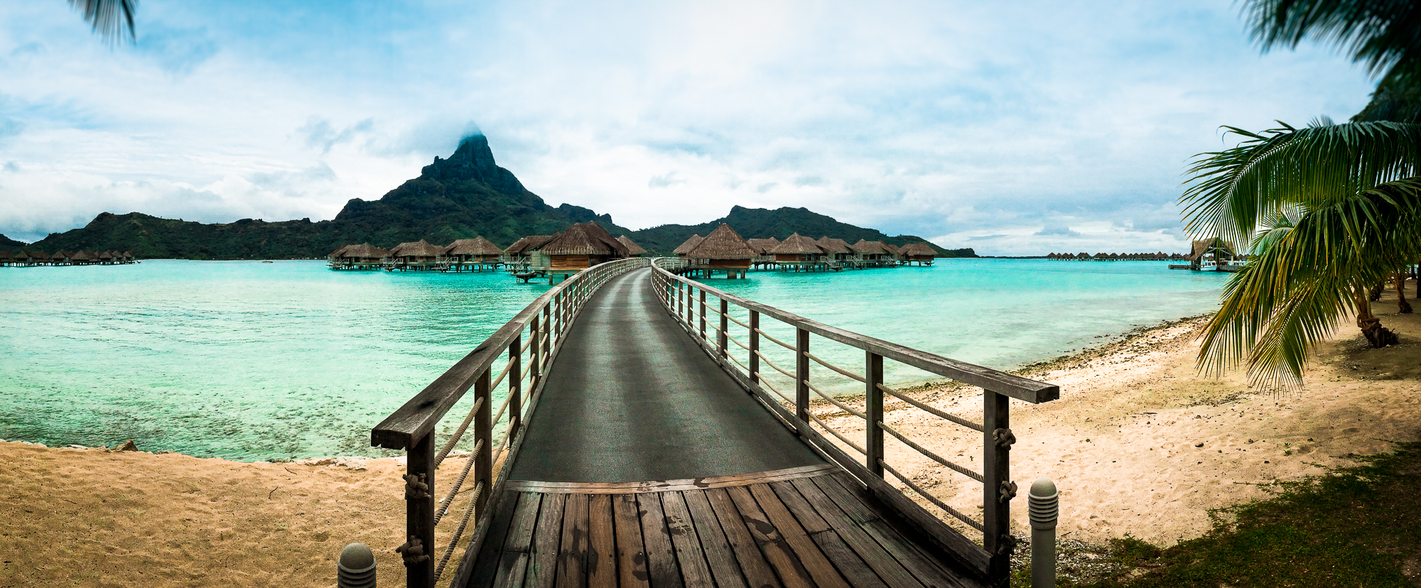 Bora Bora, the pristine paradise just south of Tahiti, is built from the flooded caldera of a long-dormant volcano. This creates a ring of lush islands surrounding a turquoise lagoon.
