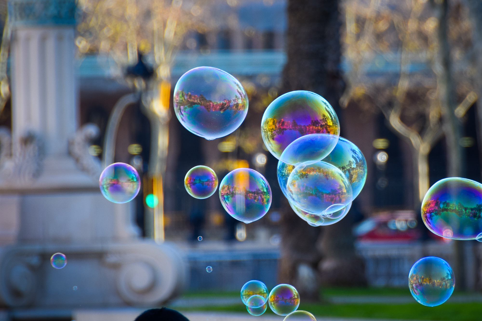 Barcelona, a city at the heart of the Catalonian area of Spain, is captivating from its buildings, to its parks, and, most of all, its people. No greater joy can be found than a child playing with bubbles in a historic park.