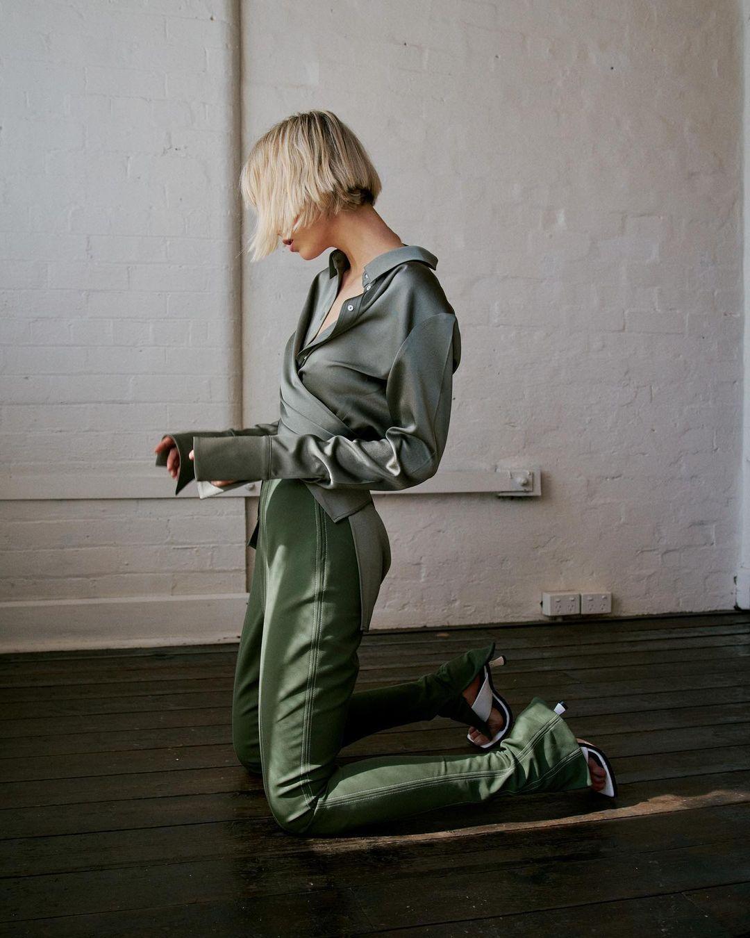Girl kneeling in shirt. Shot by Ben Jones - Northbrook Agency.