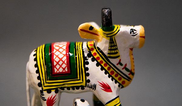 Wooden handcrafted figurine of Kamdhenu, the divine cow