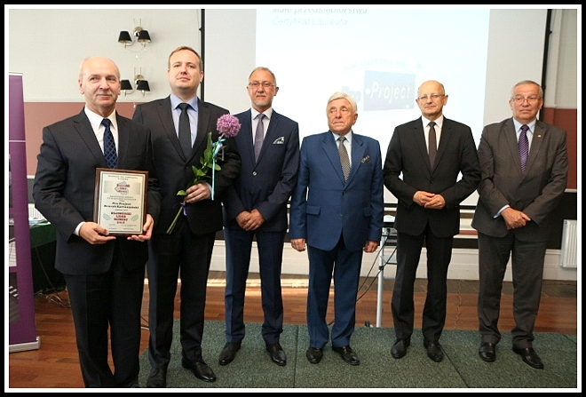 Rafał Kartaszyński and Henryk Kartaszyński are posing for the picture with four other men.